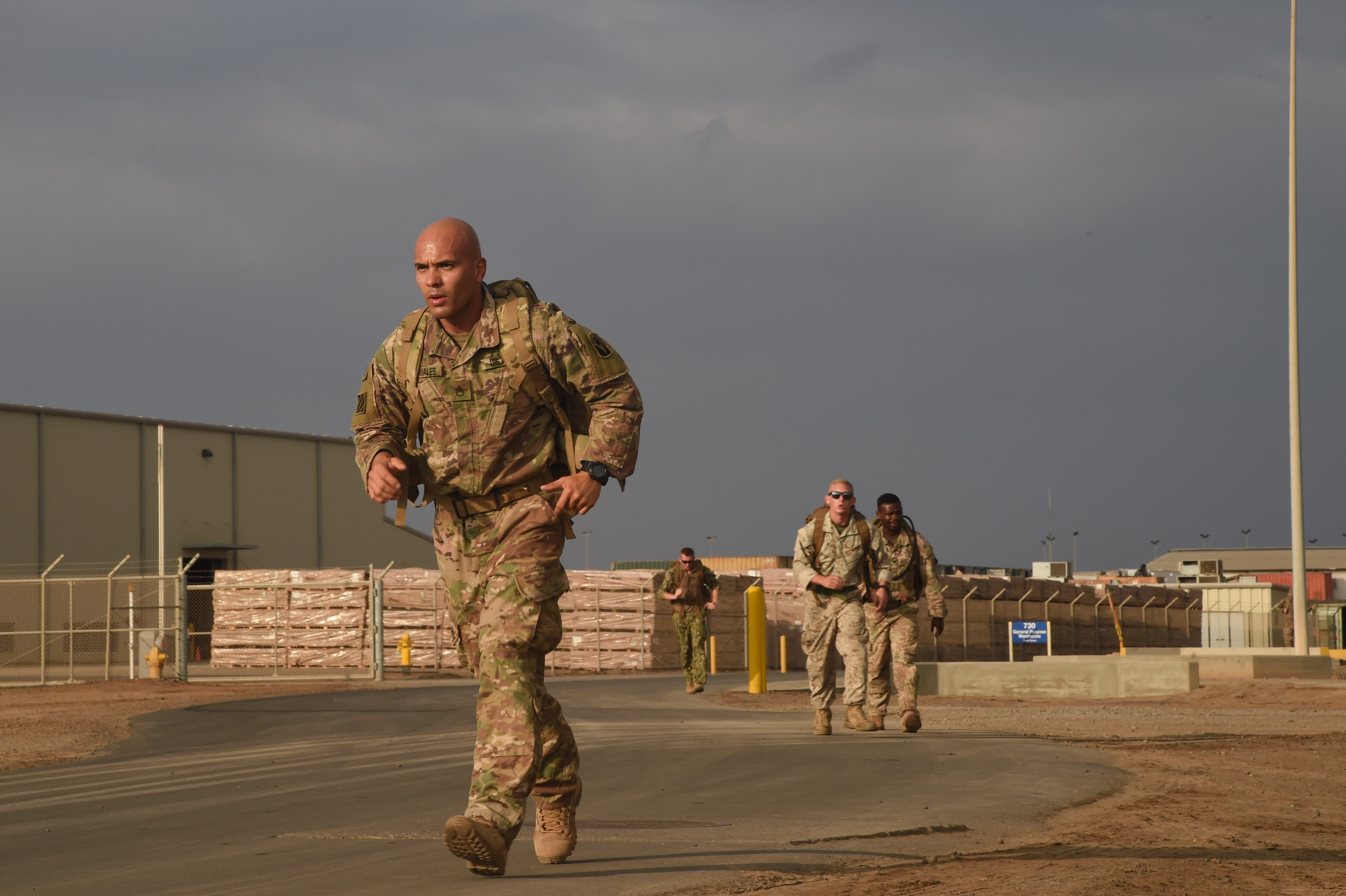 U.S. Army Staff Sgt. Juan Grisales, Combined Joint Task Force-Horn of Africa, endures a five-mile Army ruck march during the Joint Warrior Competition, Nov. 19, 2016, Camp Lemonnier, Djibouti. The ruck march began after participants had already completed a two-mile run, pull-ups, sit-ups, and push-ups. Members had to carry a minimum of 35 pounds during the march. (U.S. Air National Guard photo by Staff Sgt. Penny Snoozy)