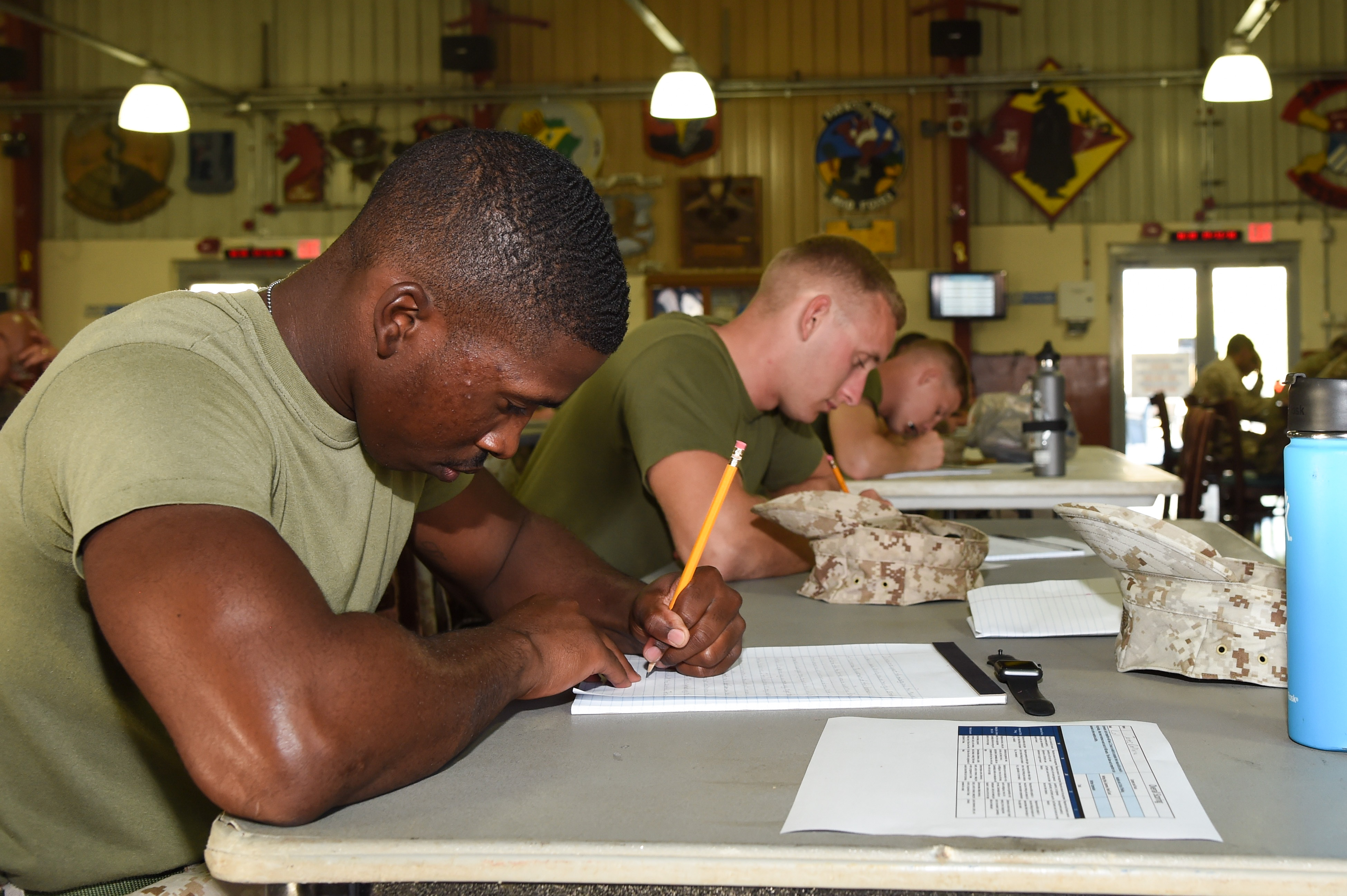 Participants write an essay during the final portion of the Joint Warrior Competition, Nov. 19, 2016, Camp Lemonnier, Djibouti. Members were given one and a half hours to complete an essay with a minimum of 400 words. The essay was supposed to focus on the mission at Combined Joint Task Force-Horn of Africa and Camp Lemonnier's strategic importance. (U.S. Air National Guard photo by Staff Sgt. Penny Snoozy)