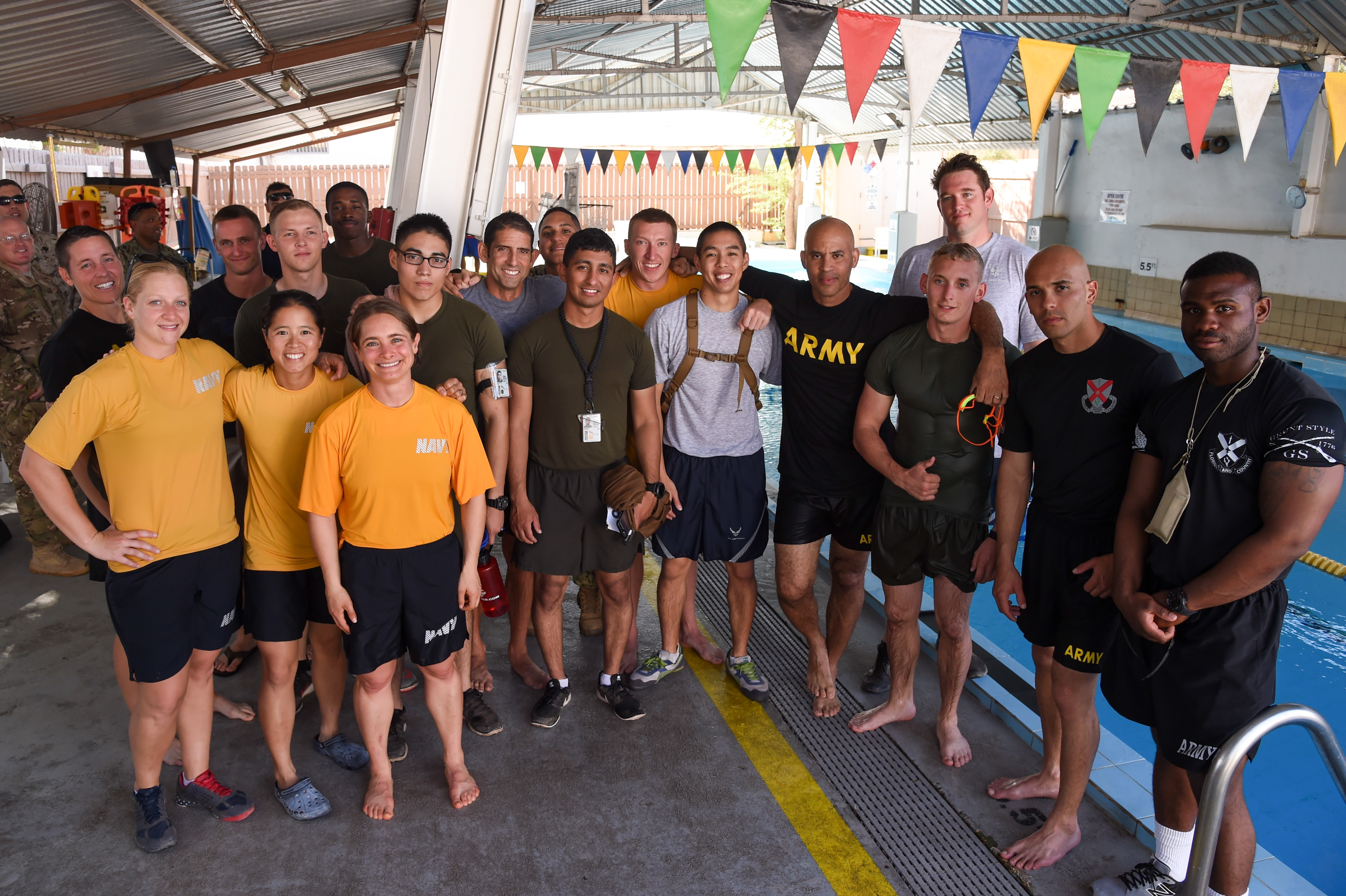 U.S. service members assigned to Combined Joint Task Force-Horn of Africa and Camp Lemonnier pose for a group photo after finishing the 240-meter Navy swim test for the Joint Warrior Competition, Nov. 19, 2016, Camp Lemonnier, Djibouti. Before the swim test, competitors completed a joint physical fitness test and a joint combat fitness test comprised of: pull-ups, push-ups, sit-ups, two-mile run, five-mile ruck march, a low crawl, tourniquet application, buddy carry, radio medical evacuation, grenade toss, tire flip, ammo can carry, dead lift, and rope climb. (U.S. Air National Guard photo by Staff Sgt. Penny Snoozy)