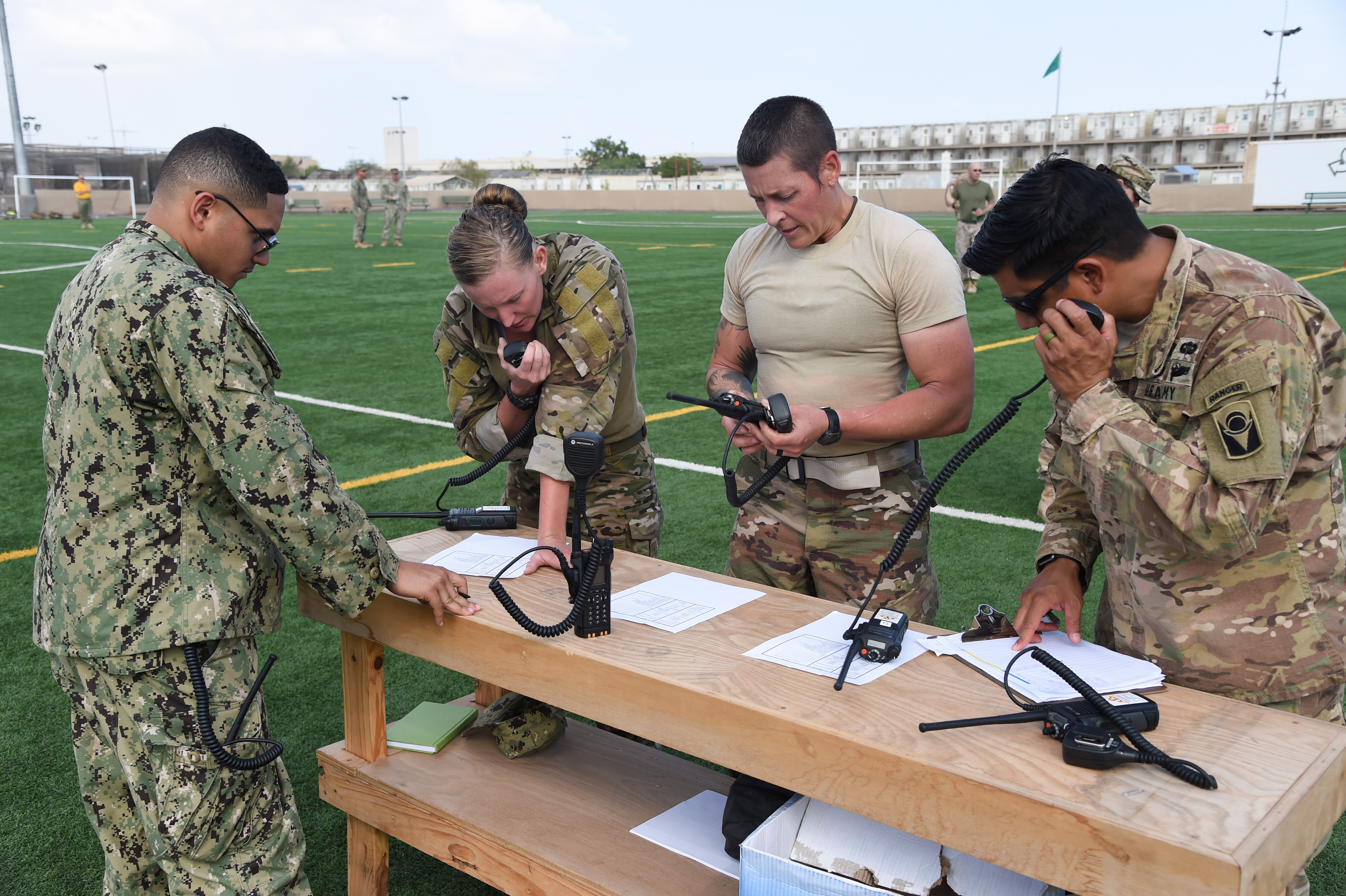 U.S. service members assigned to Combined Joint Task Force-Horn of Africa and Camp Lemonnier call in to arrange a simulated medical evacuation after a buddy carry during the Joint Warrior Competition, Nov. 19, 2016, Camp Lemonnier, Djibouti. After the joint physical fitness test, participants started the joint combat fitness test. The combat test was comprised of a low crawl, tourniquet application, buddy carry, radio medical evacuation, grenade toss, tire flip, ammo can carry, dead lift, and rope climb. (U.S. Air National Guard photo by Staff Sgt. Penny Snoozy)