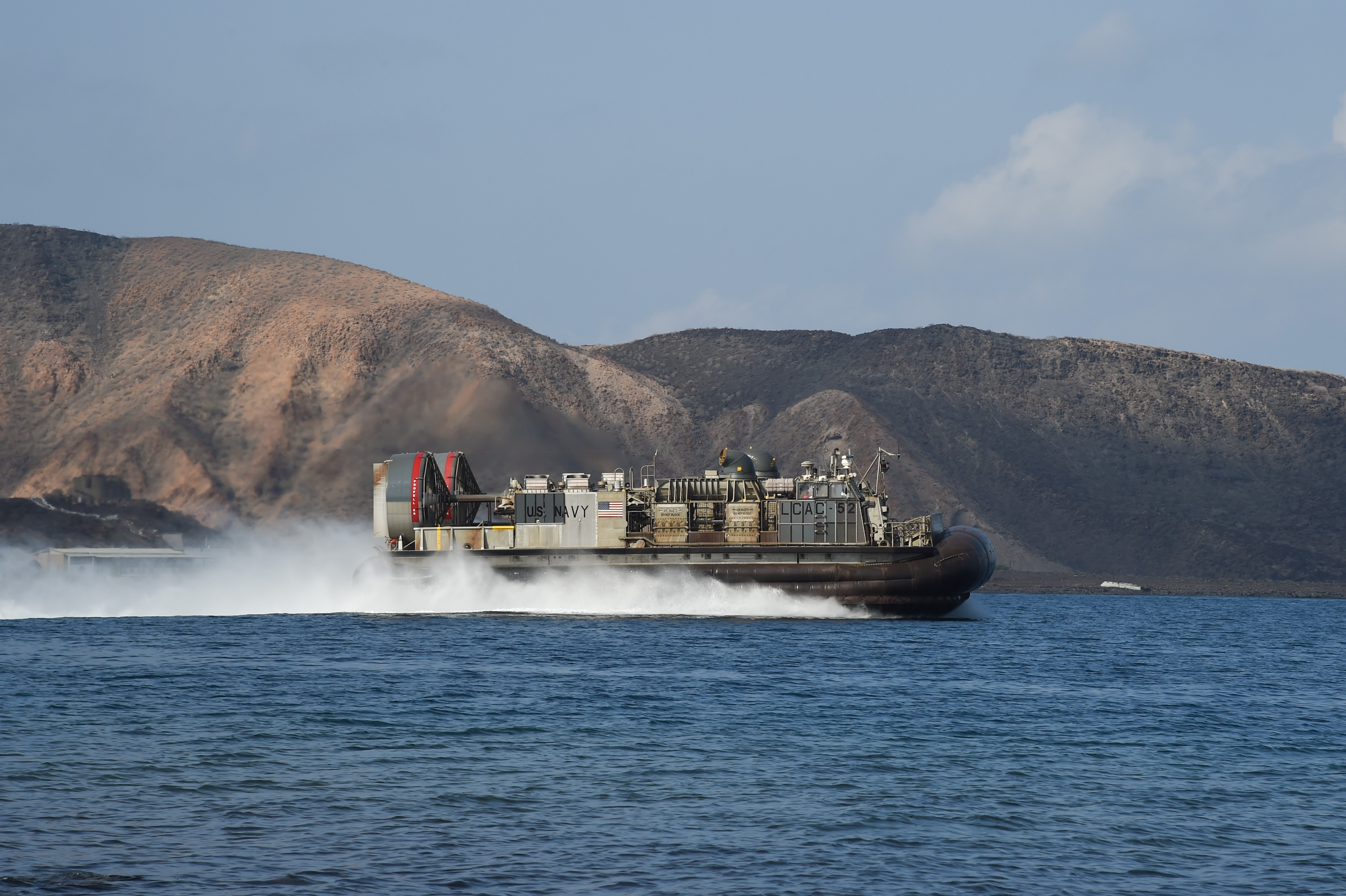 U.S. Marine Corps members with the 11th Marine Expeditionary Unit, USS Makin Island Amphibious Ready Group, are transported to shore via Landing Craft Air Cushion (LCAC), Dec. 7, 2016, at Arta Plage, Djibouti. A MEU is a quick response force, which consists of Sailors and Marines on standby for immediate crisis response across the globe. (U.S. Air National Guard photo by Staff Sgt. Penny Snoozy)