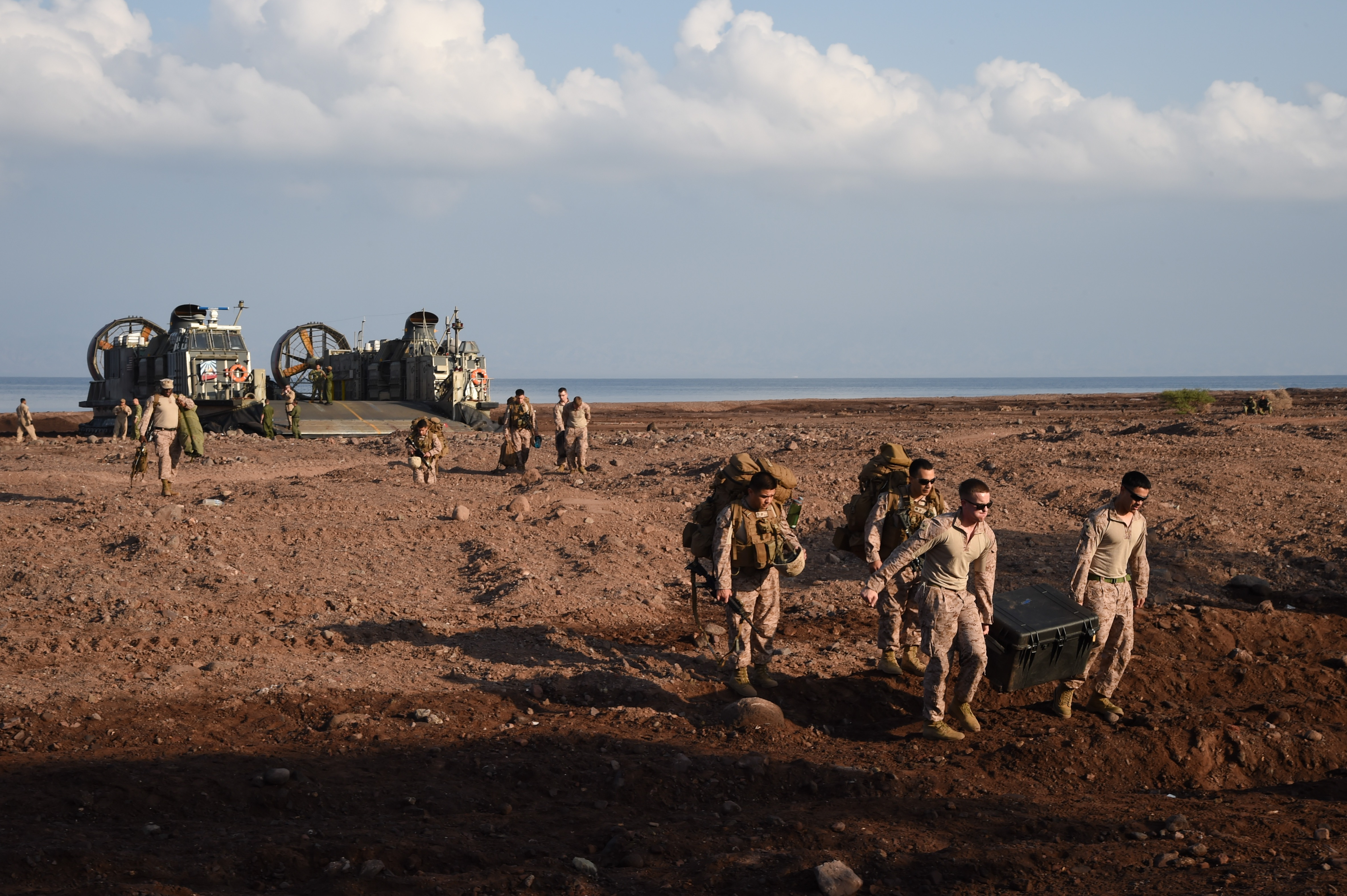 U.S. Marine Corps combat logistics battalion members with the 11th Marine Expeditionary Unit, offload from a Landing Craft Air Cushion (LCAC) amphibious vehicle, Dec. 7, 2016, at Arta Plage, Djibouti. The capabilities of the LCAC permit crucial access for up to 75 tons worth of passengers and cargo to be transported from ship-to-shore. (U.S. Air National Guard photo by Staff Sgt. Penny Snoozy)