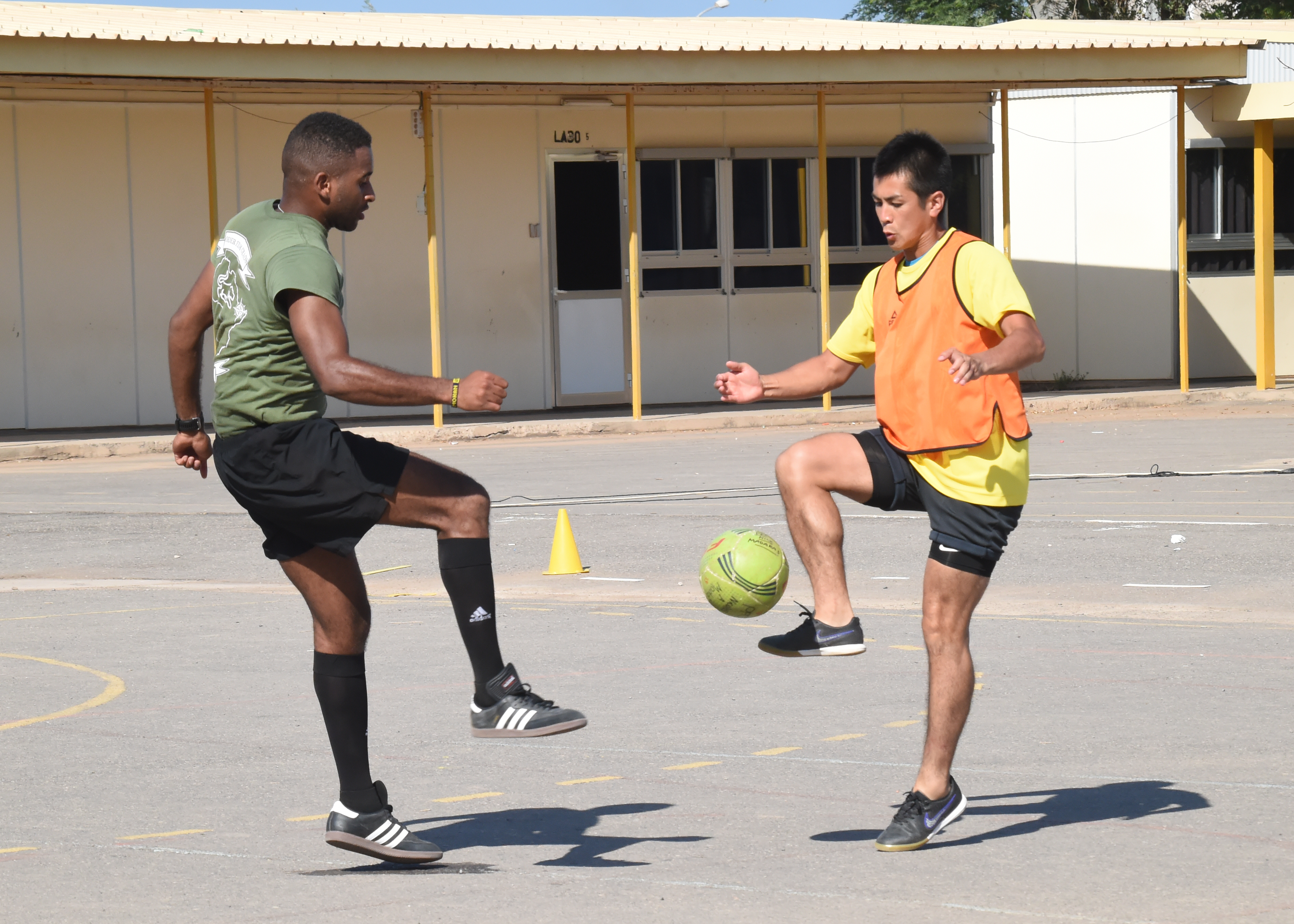 Soccer players representing military units from the U.S. and Japan face off on the field during a friendly soccer tournament supporting the Kick for Nick Foundation at the French school Kessel in downtown Djibouti Dec. 9, 2016. The event brought together eleven different teams from six countries for friendly competition in support of the Kick for Nick Foundation. (U.S. Air National Guard photo by Master Sgt. Paul Gorman)