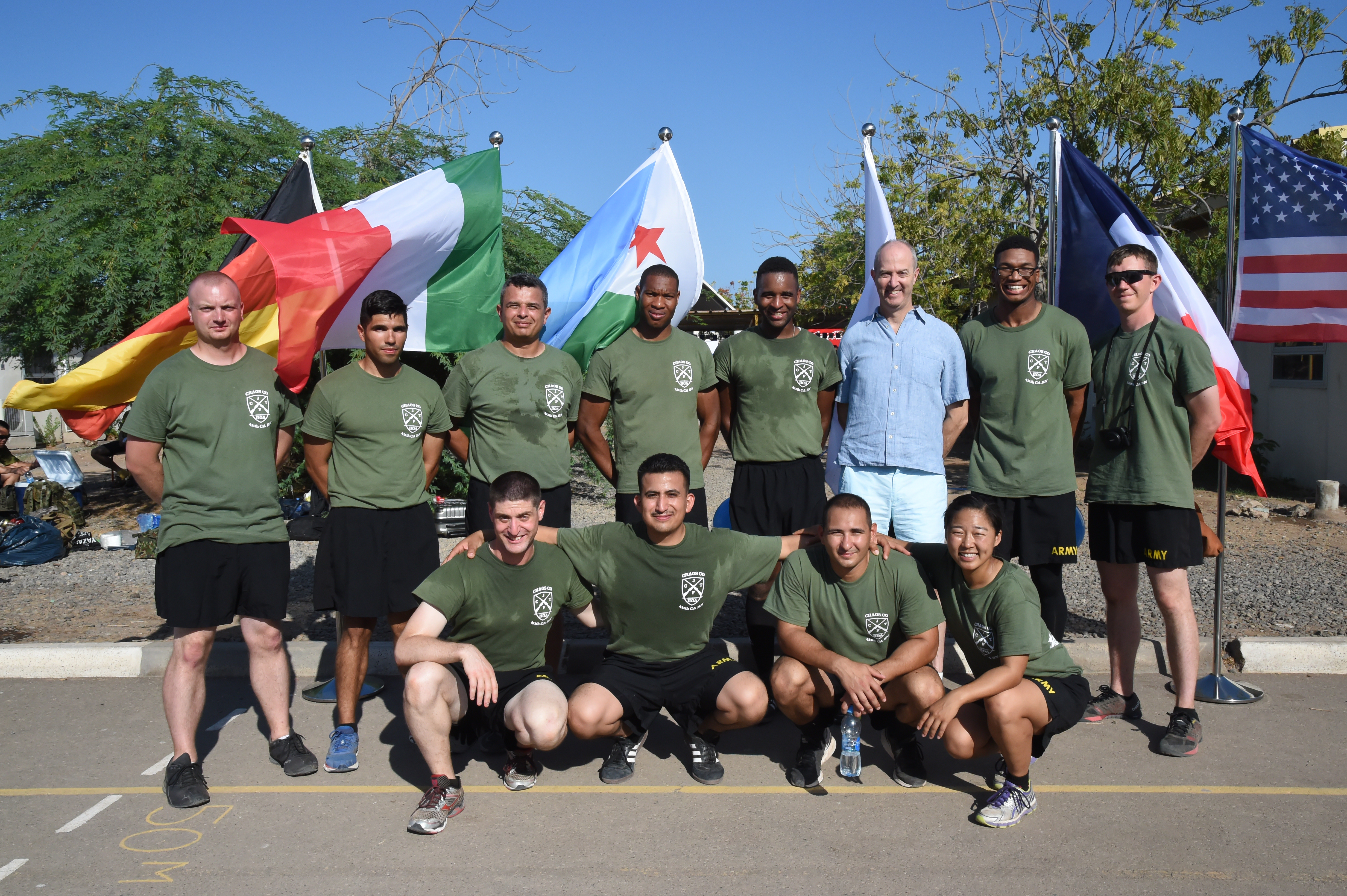 A soccer team comprised of U.S. Army Reserve Soldiers from Charlie Company of the 411th Civil Affairs Battalion pause for a photo with U.S. Ambassador to Djibouti Tom Kelly during a tournament at the French school Kessel in downtown Djibouti Dec. 9, 2016. The event brought together eleven different teams from six countries for friendly competition in support of the Kick for Nick Foundation. (U.S. Air National Guard photo by Master Sgt. Paul Gorman)