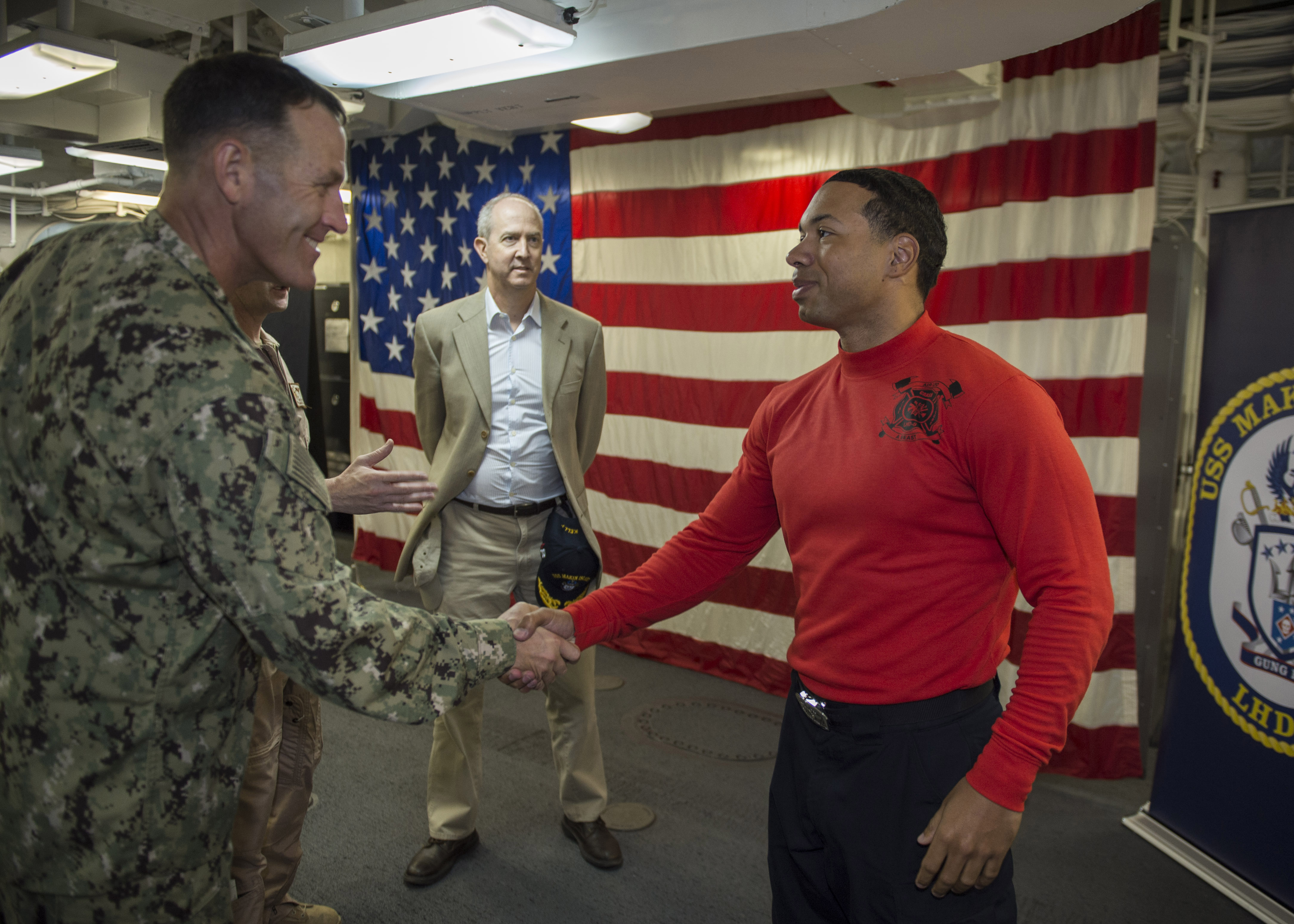 U.S. 5TH FLEET AREA OF OPERATIONS (Dec. 16, 2016) Rear Adm. William W. Wheeler, Deputy Commander, Combined Joint Task Force – Horn of Africa, greets USS Makin Island (LHD 8) Sailor of the Year, Petty Officer 1st Class Benjamin Odea, from Lansing, Mich., during a tour aboard the amphibious assault ship. Makin Island is deployed as part of the Makin Island Amphibious Ready group to the U.S. 5th Fleet area of operations to support maritime security operations and theater security cooperation efforts. (U.S. Navy photo by Petty Officer 3rd Class Devin M. Langer)
