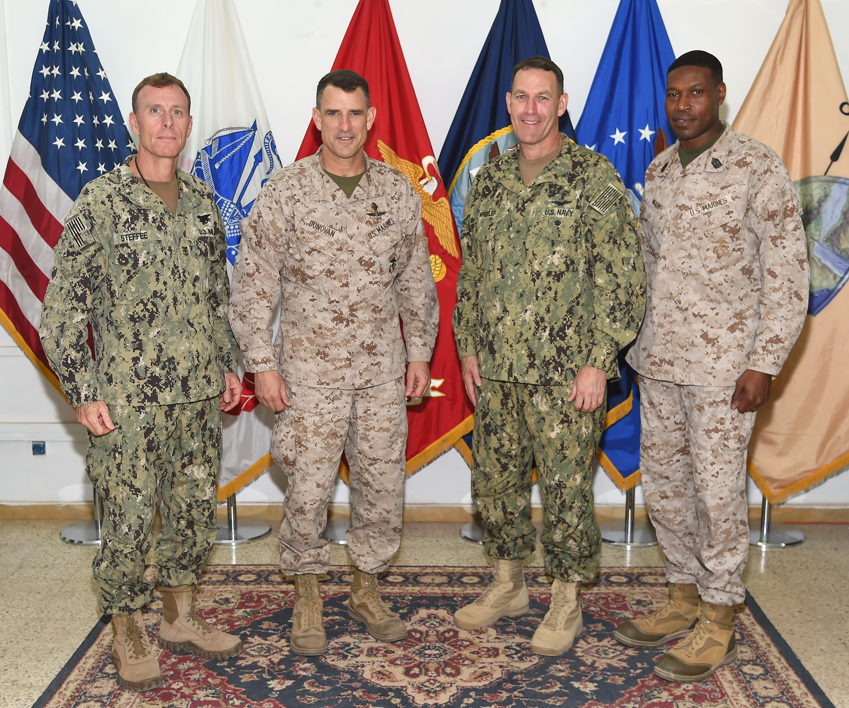 5th Marine Expeditionary Brigade and Combined Task Force 51 Commander, Brig. Gen. Francis Donovan, and Command Sgt. Maj. Clifford Wiggins, 5th MEB and CTF-51 command sergeant major, meet with Combined Joint Task Force - Horn of Africa Deputy Commander, Rear Adm. William Wheeler and CJTF-HOA Command Senior Enlisted Leader, Command Master Chief Geoffrey Steffee during a visit to Camp Lemonnier, Djibouti Dec. 20, 2016. In addition to meeting with CJTF-HOA and Camp Lemonnier leadership, Donovan observed joint training at the Djibouti Range Complex in Arta, and met with Sailors and Marines aboard the amphibious assault ship USS Makin Island (LHD 8). (U.S. Air National Guard photo by Master Sgt. Paul Gorman)