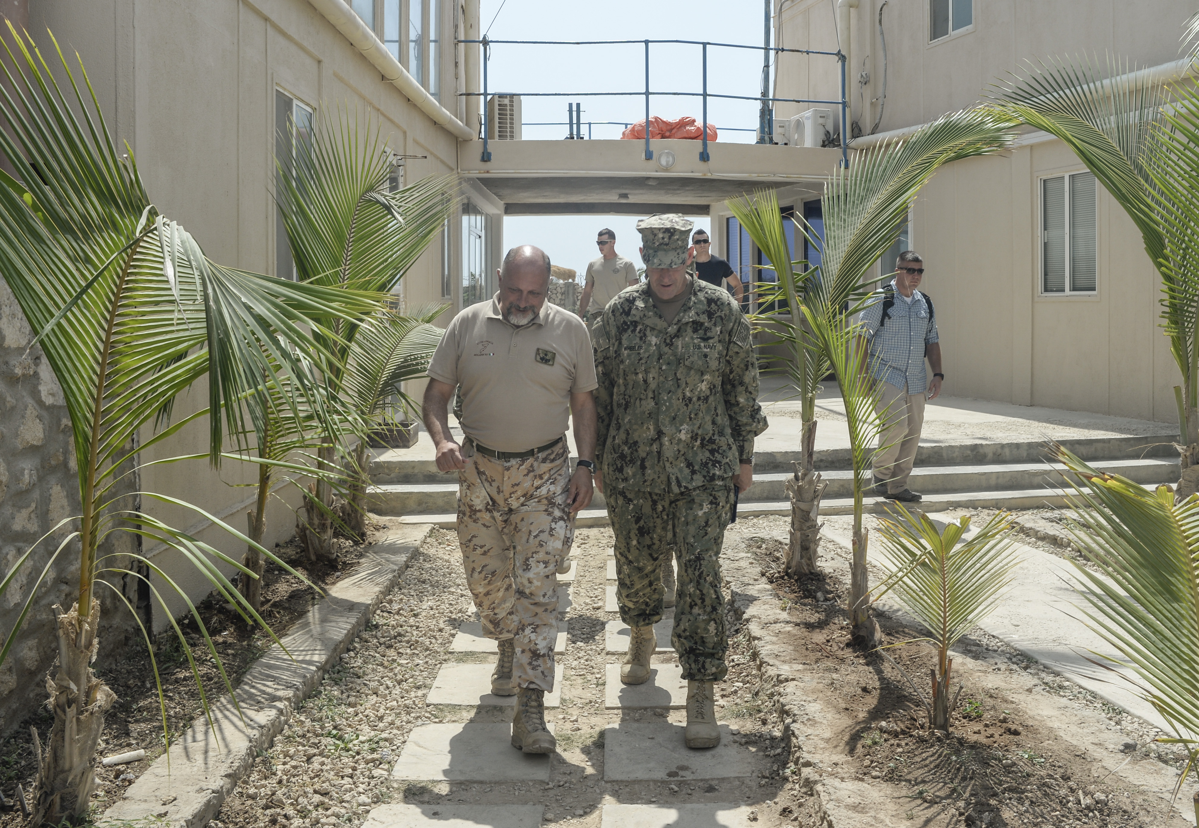 MOGADISHU, SOMALIA- Italian Army Brig. Gen. Maurizio Morena, European Union Training Mission Somalia commander, discusses the current status of Somalia with U.S. Navy Rear Adm. William Wheeler III, Combined Joint Task Force-Horn of Africa (CJTF-HOA) deputy commander, in Mogadishu, Somalia Dec. 19, 2016.  These meetings help to coordinate CJTF-HOA, European Union, United Nations, African Union Mission in Somalia and other international partner's efforts to stabilize Somalia and the surrounding regions.