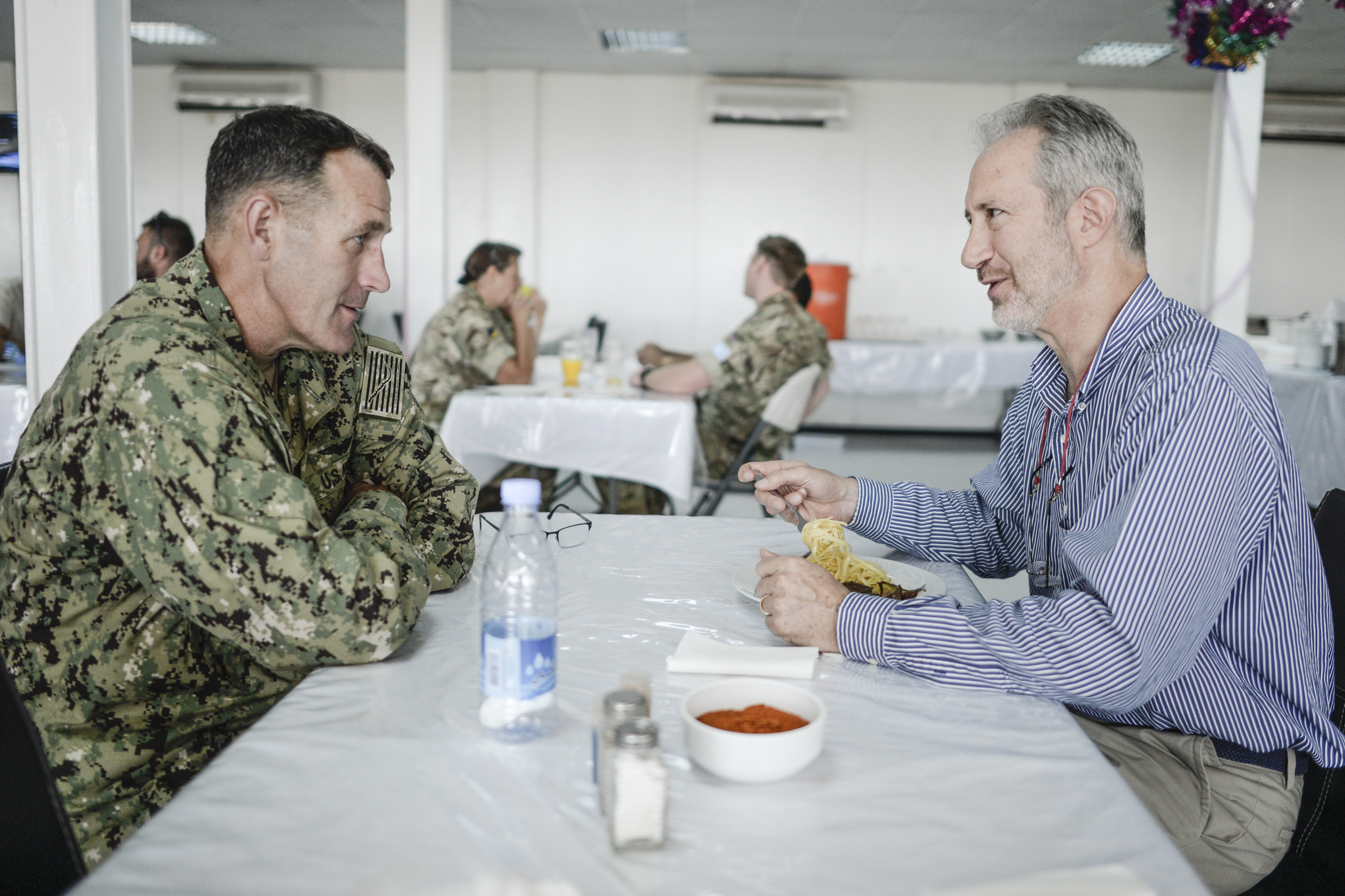 MOGADISHU, SOMALIA- U.S. Navy Rear Adm. William Wheeler III, Combined Joint Task Force-Horn of Africa (CJTF-HOA) deputy commander, and U.S. Ambassador Stephen Schwartz, U.S. Ambassador to Somalia, meet over  lunch to discuss the current political and economic environment in Somalia Dec. 19, 2016. Such meetings improve the capability of U.S. and partner nations to create favorable conditions for the expansion of stable governance and economic development in Somalia.