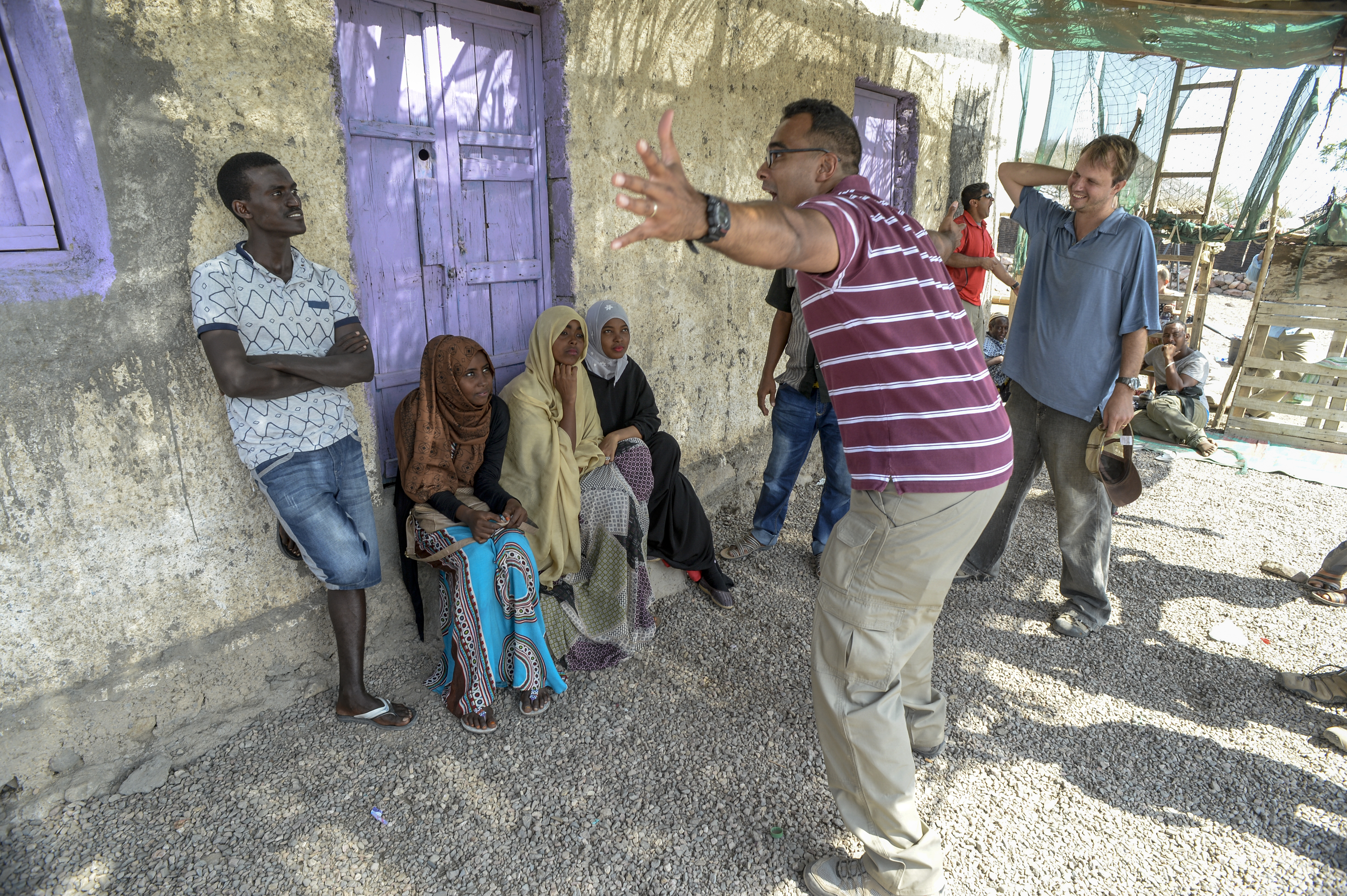 "U.S. Army Sgt. Gregory Williams, civil affairs, and Matt Hahn, International Development and Relief Board (IDRB,) explain a scene to the cast of ""Ahmed the Herder"" before the video shoot in a village near Tadjourah, Djibouti, Dec. 15, 2016.  ""Ahmed the Herder"" is a video series that teaches best practices in animal health care, and is facilitated by U.S. Army civil affairs personnel for the IDRB. (U.S. Air National Guard photo by Staff Sgt. Christian Jadot)"