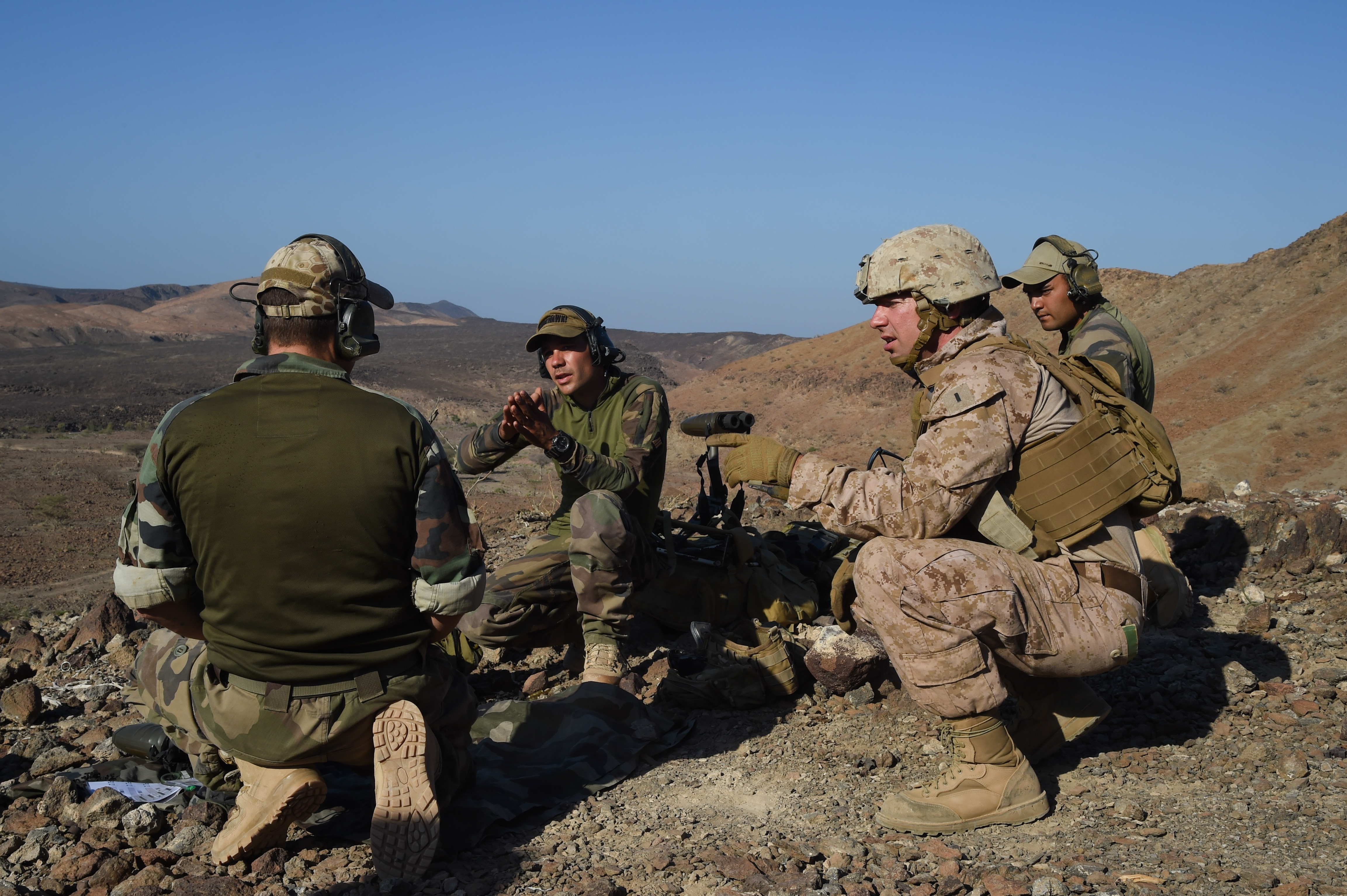 U.S. Marine Corps 2nd Lt. Joshua Gray, Scout Sniper Platoon, Battalion Landing Team 1st Battalion, 4th Marines, 11th Marine Expeditionary Unit, watches the range through a scope at an unknown distance course during exercise Alligator Dagger, Dec. 13, 2016, Arta Plage, Djibouti. The range practice was part of bilateral training with the 3rd Infantry French Marines Sniper Platoon. (U.S. Air National Guard photo by Staff Sgt. Penny Snoozy)