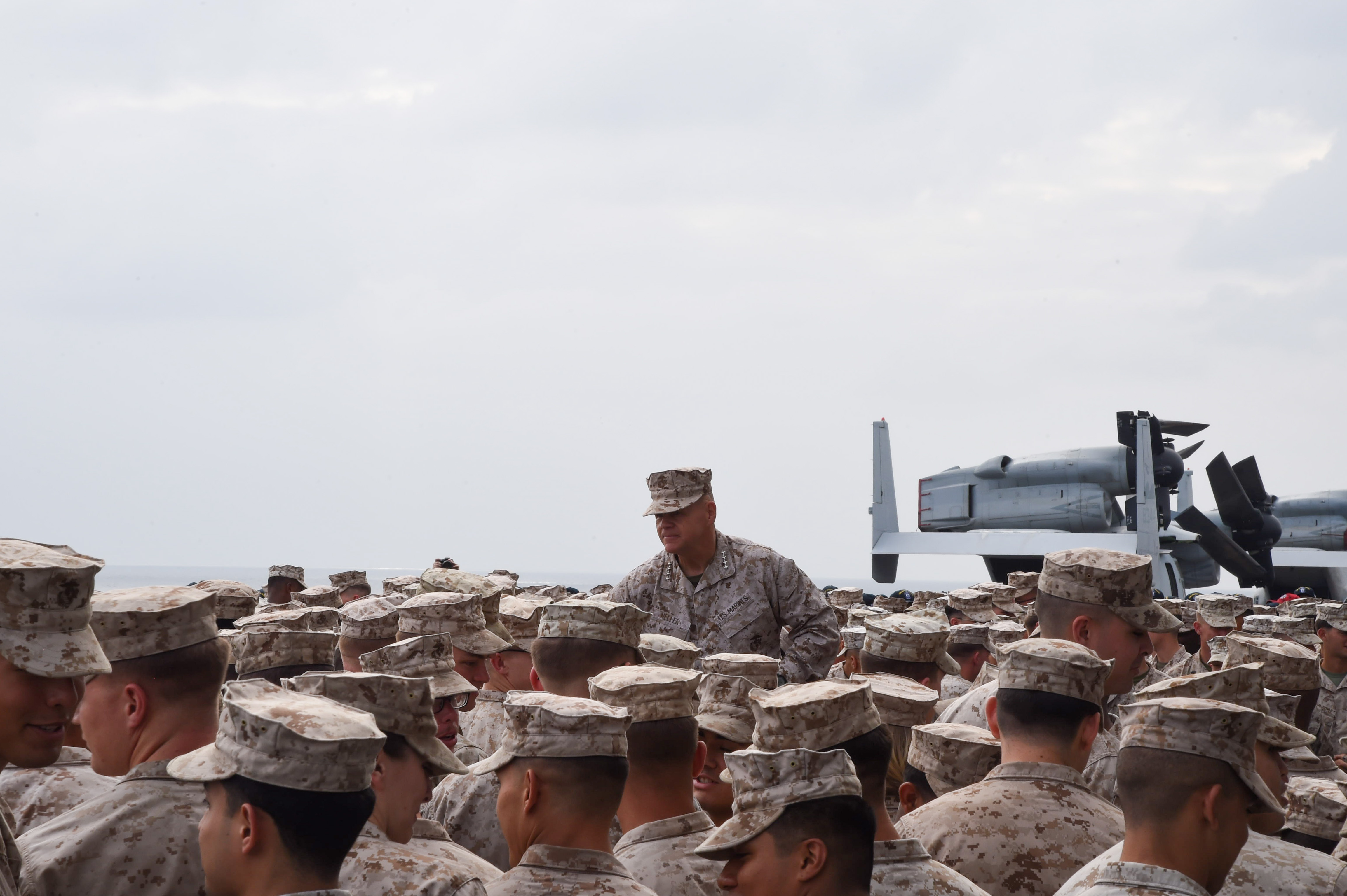 U.S. Marine Corps Gen. Robert B. Neller, 37th Commandant of the Marine Corps, speaks to Marines with the 11th Marine Expeditionary Unit and Sailors assigned to the amphibious assault ship USS Makin Island (LHD 8), on the flight deck of the Makin Island, in the Gulf of Aden, Dec. 23, 2016. The Commandant and Sergeant Major of the Marine Corps conducted a holiday tour to visit Marines and Sailors stationed overseas and forward deployed. (U.S. Air National Guard photo by Staff Sgt. Penny Snoozy)
