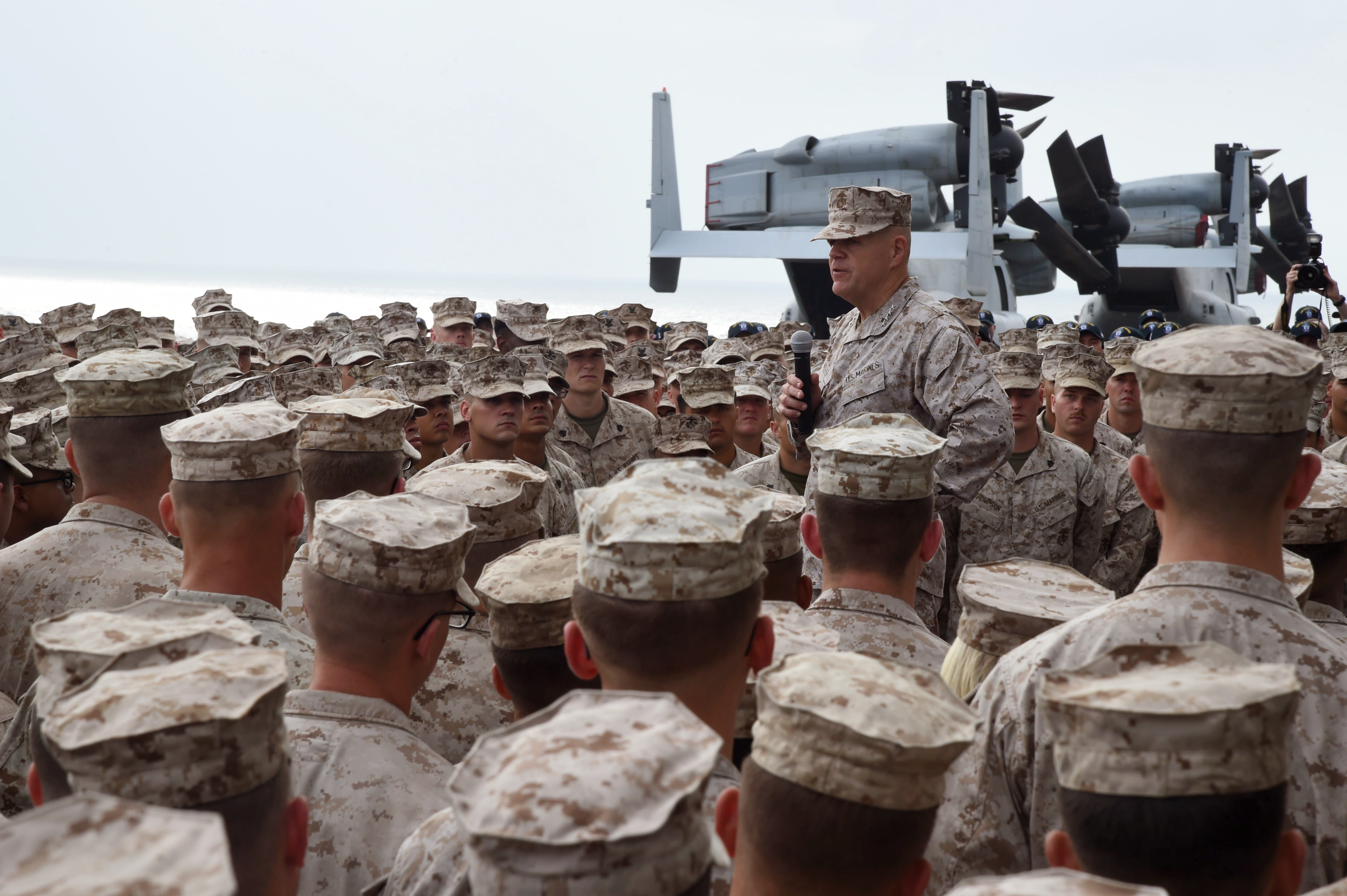 U.S. Marine Corps Gen. Robert B. Neller, 37th Commandant of the Marine Corps, speaks to Marines with the 11th Marine Expeditionary Unit and Sailors assigned to the amphibious assault ship USS Makin Island (LHD 8), on the flight deck the Makin Island, in the Gulf of Aden, Dec. 23, 2016. The Commandant and Sergeant Major of the Marine Corps conducted a holiday tour to visit Marines and Sailors stationed overseas and forward deployed. (U.S. Air National Guard photo by Staff Sgt. Penny Snoozy)
