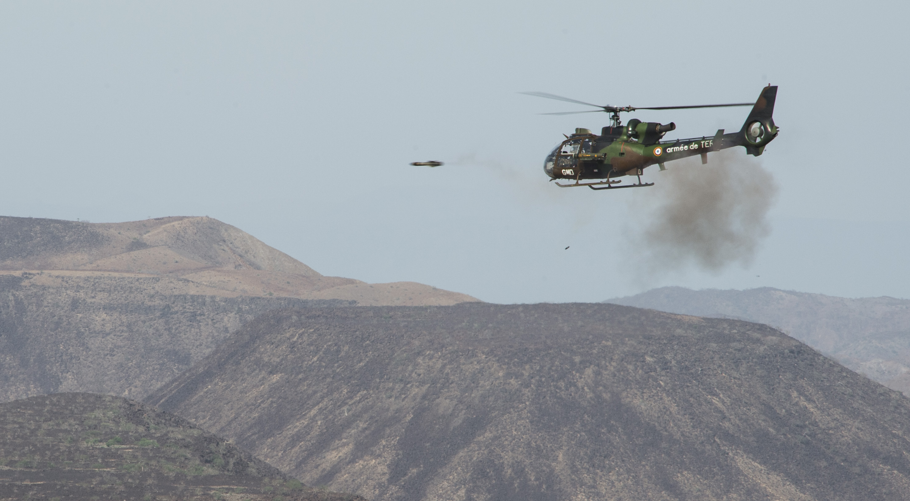 A French SA 342 Gazelle utility helicopter fires a live missile at simulated targets during the French live fire demonstration near Arta Plage, Djibouti, Jan. 14, 2017. The SA 342 Gazelle is a light, five-seat helicopter often used by various militaries for reconnaissance and light attack duties. (U.S. Air National Guard photo by:  Staff Sgt. Christian Jadot)