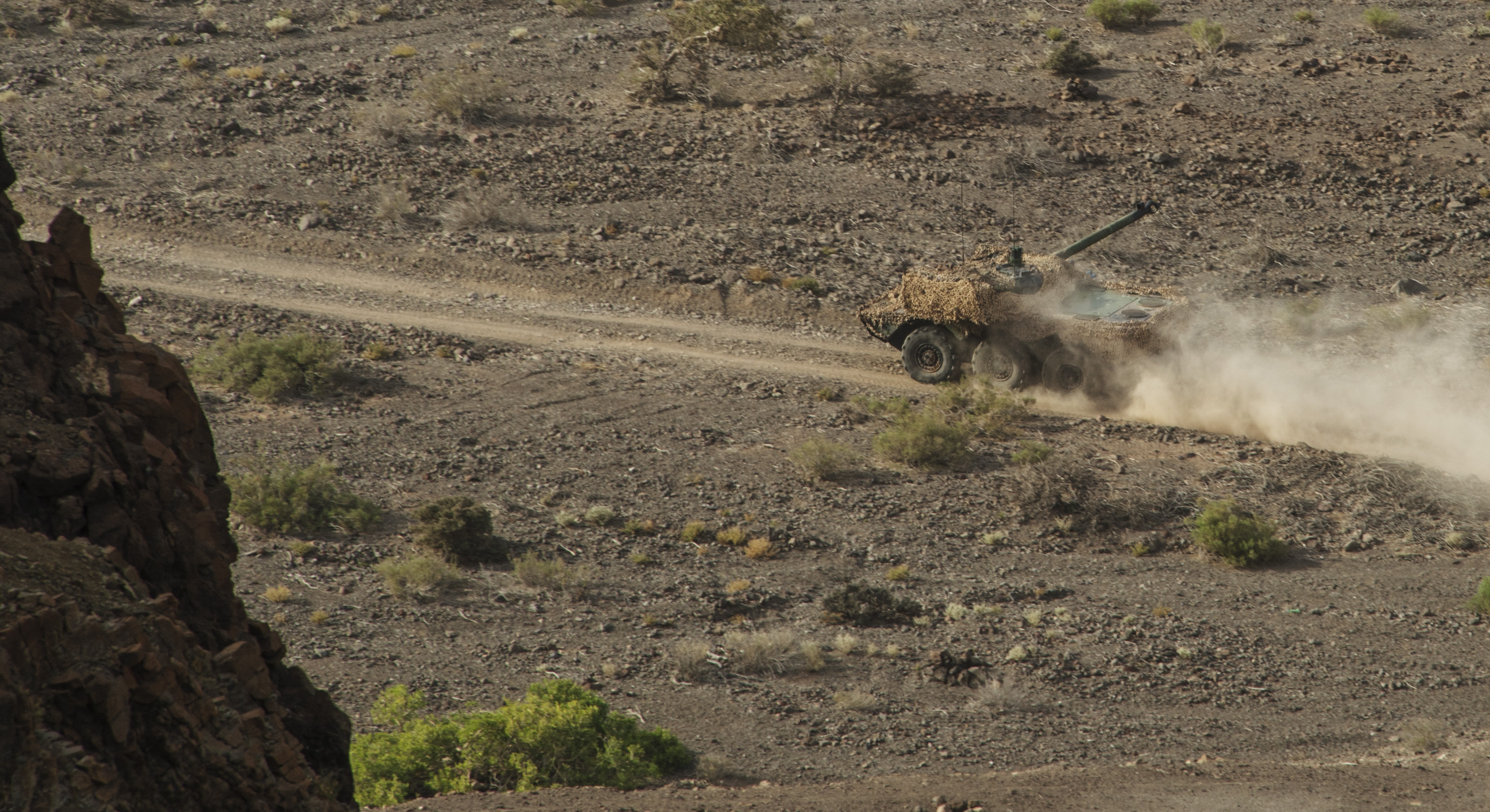 A French AMX-10RCR wheeled armored reconnaissance vehicle keeps its barrel locked in on a simulated target while traversing the terrain during the French live fire demonstration near Arta Plage, Djibouti, Jan. 14, 2017. The AMX-10RCR was developed for light reconnaissance and troop fire support and is capable of engaging other armored vehicles. (U.S. Air National Guard photo by:  Staff Sgt. Christian Jadot)