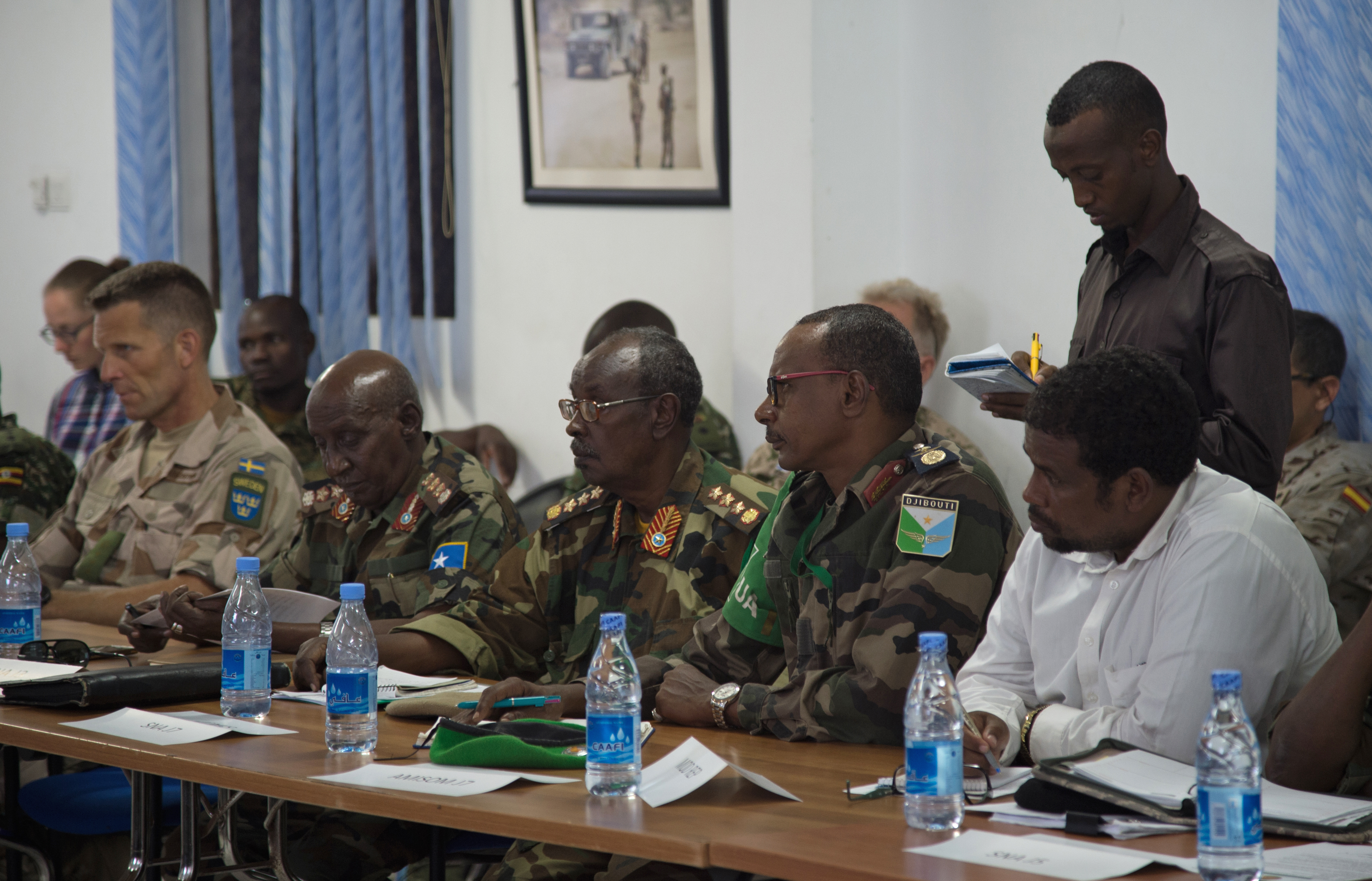Leaders of the Somali National Army meet with international military and civilian officials to discuss the future of Somalia's security at the SNA Symposium in downtown Mogadishu, Jan. 11, 2017. More than 60 participants attended the two-day event, including representatives from Denmark, Germany, Italy, Somalia, Turkey, Uganda, the United Arab Emirates, United Kingdom and the United States of America. Also in attendance, were representatives from international organizations such as the United Nations, European Union Training Mission, and the African Union Mission in Somalia.