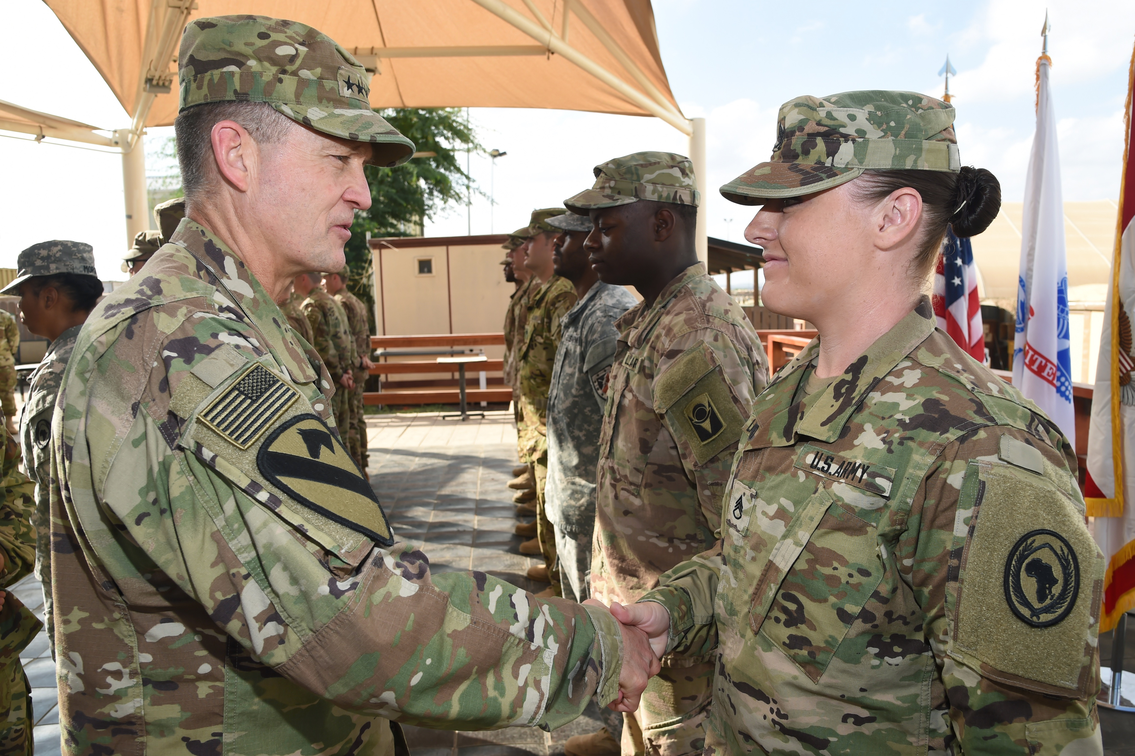 Vice Chief of Staff of the Army Gen. Daniel B. Allyn recognizes Army Staff Sgt. Kendra Langsford for outstanding performance as an intelligence noncommissioned officer at Camp Lemonnier, Djibouti, Jan. 16, 2017. Allen's visit included the opportunity to meet with leadership to discuss on-going operations and challenges in the region, as well as recognize numerous deployed service members for outstanding performance in support of Camp Lemonnier, and Combined Joint Task Force-Horn of Africa. (U.S. Air National Guard photo by Master Sgt. Paul Gorman)