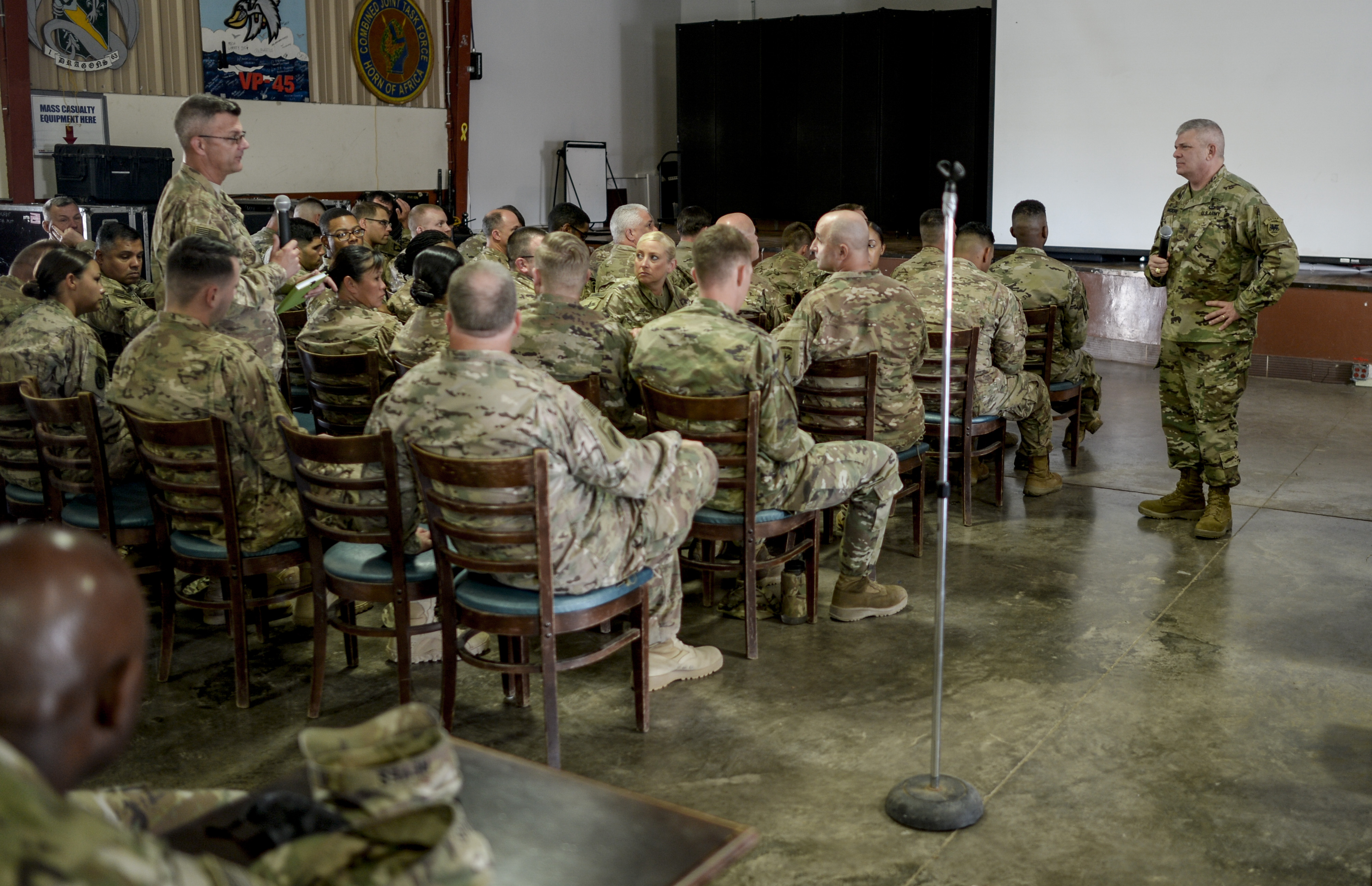 "U.S. Army Brig. Gen. Kenneth H. Moore, U.S. Army Africa deputy commander, takes a question at a ""town hall"" style meeting during his visit to Camp Lemonnier, Djibouti, Jan. 16, 2017. Brig. Gen. Moore met with Army Reservists to present an overview of the Army's mission in Africa and drive home the 'Total Army' concept."