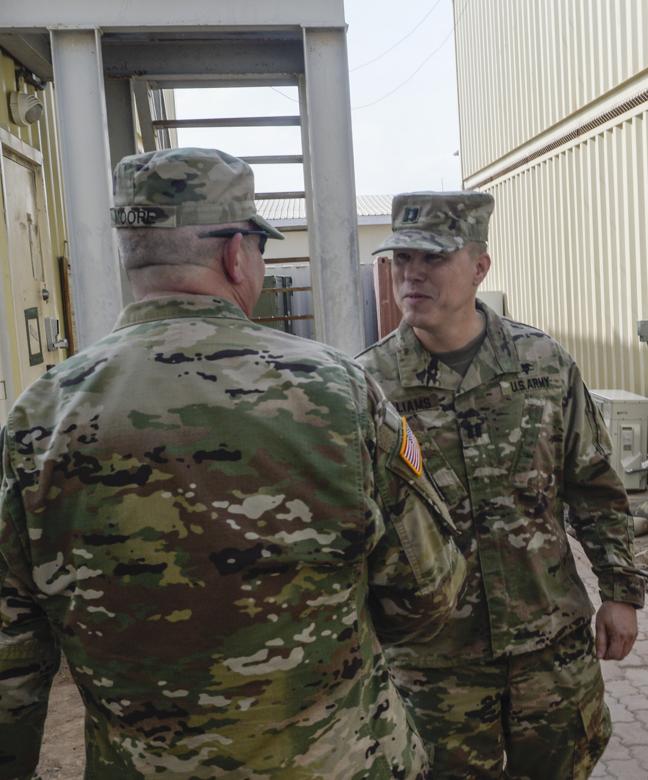 Brig. Gen. Kenneth H. Moore, U.S. Army Africa deputy commander, meets with Army Reserve members of the 411th Civil Affairs Battalion during his visit to Camp Lemonnier, Djibouti, Jan. 16, 2017.  Brig. Gen. Moore met with Army Reservists to discuss the specific challenges and objectives associated with their deployment to the Horn of Africa.