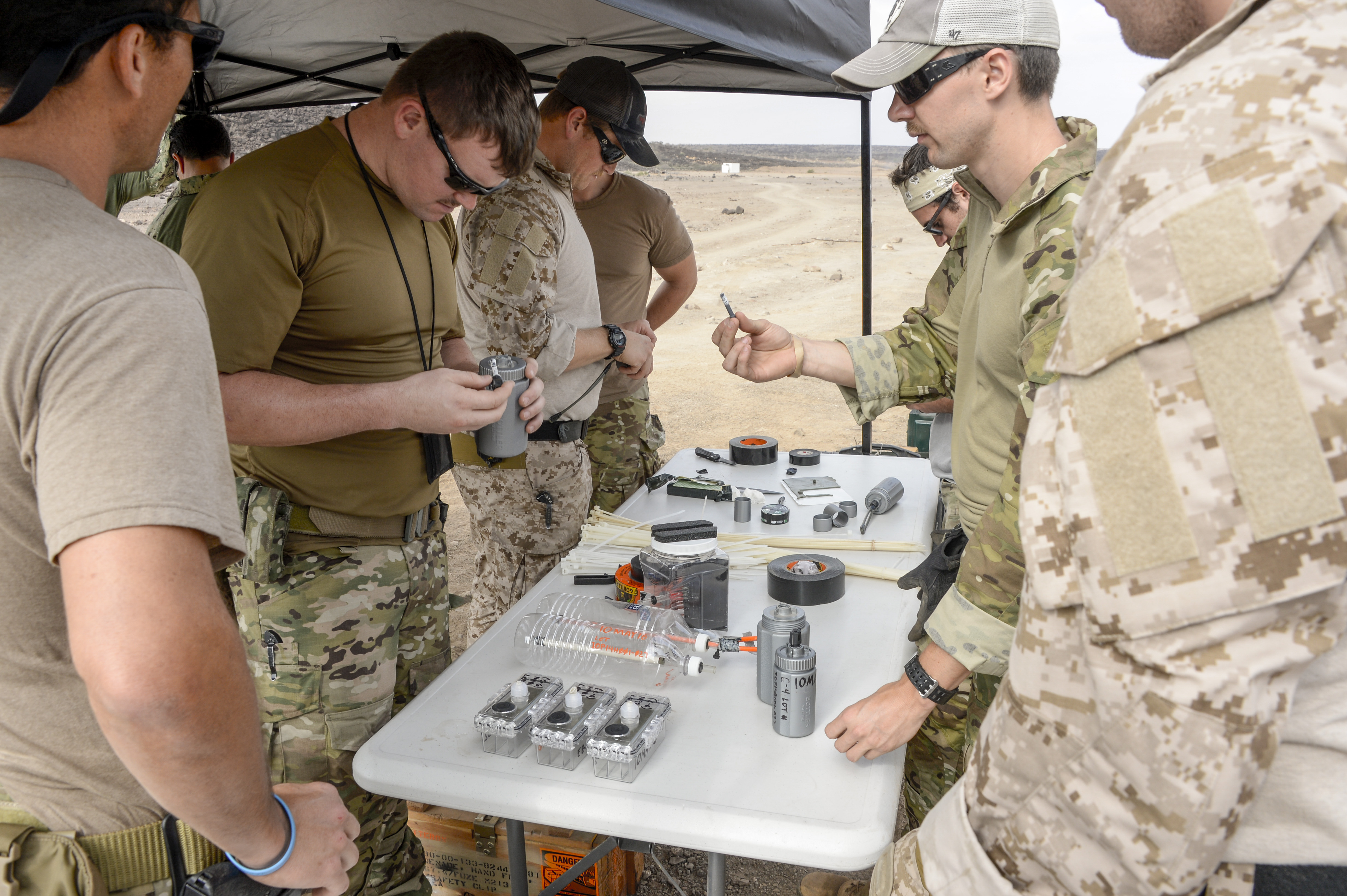 U.S. Navy Sailors of Combined Joint Task Force Horn of Africa Explosive Ordnance Disposal (EOD) members, construct explosive tools such as fluid blade disruptors and devices for training purposes at Arta Plage, Djibouti, Jan. 30, 2017. EOD teams use fluid blade disruptors to penetrate harden locations with a directed explosion. (U.S. Air National Guard photo by Staff Sgt. Christian Jadot)
