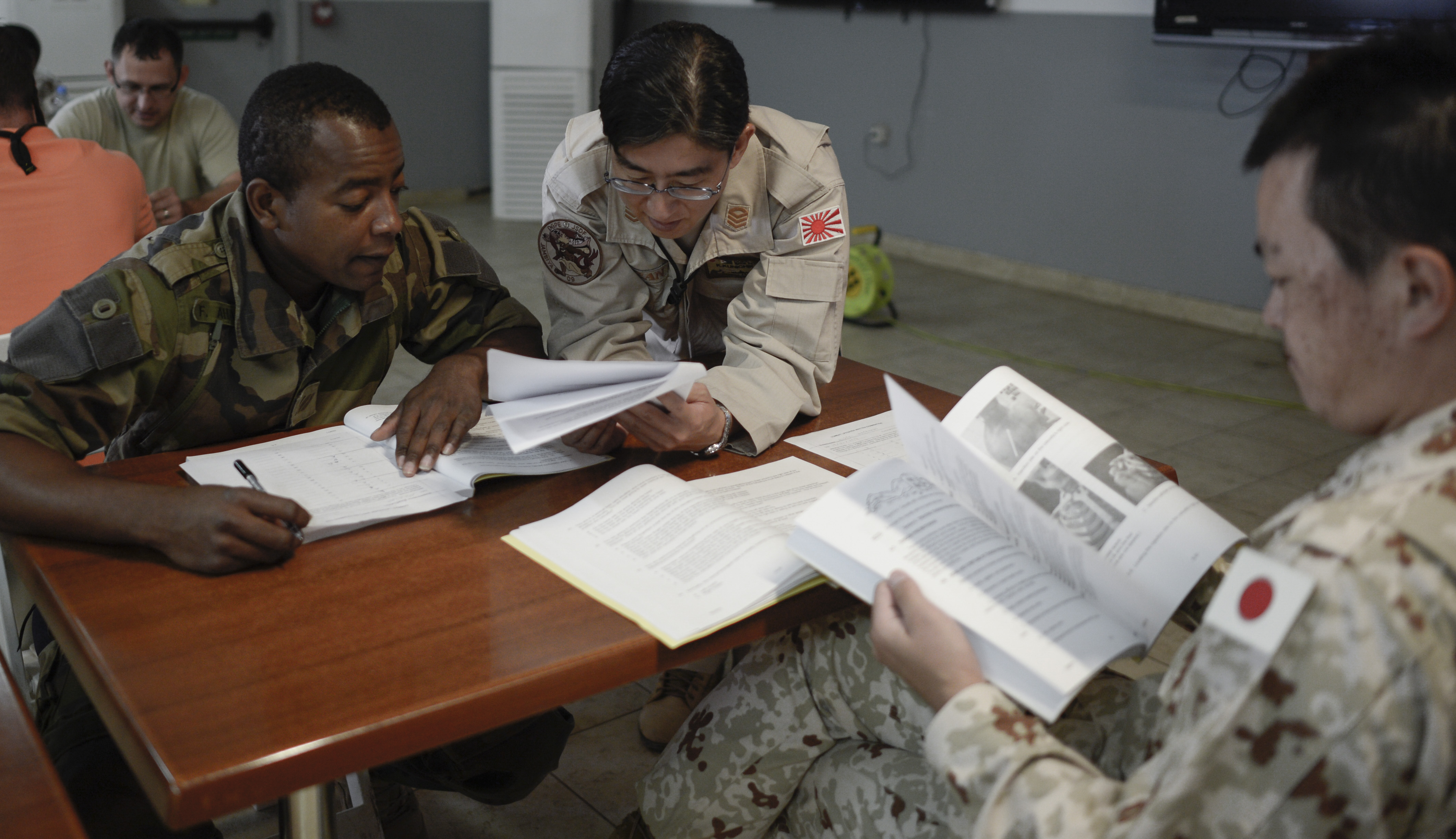 Students from U.S. partner nations take a written examination during the Combat Lifesavers Course (CLC) at Camp Lemonnier, Djibouti, Jan. 19, 2017. A properly trained combat lifesaver is capable of stabilizing many types of casualties and can slow the deterioration of a wounded service member's condition until medical personnel arrive.