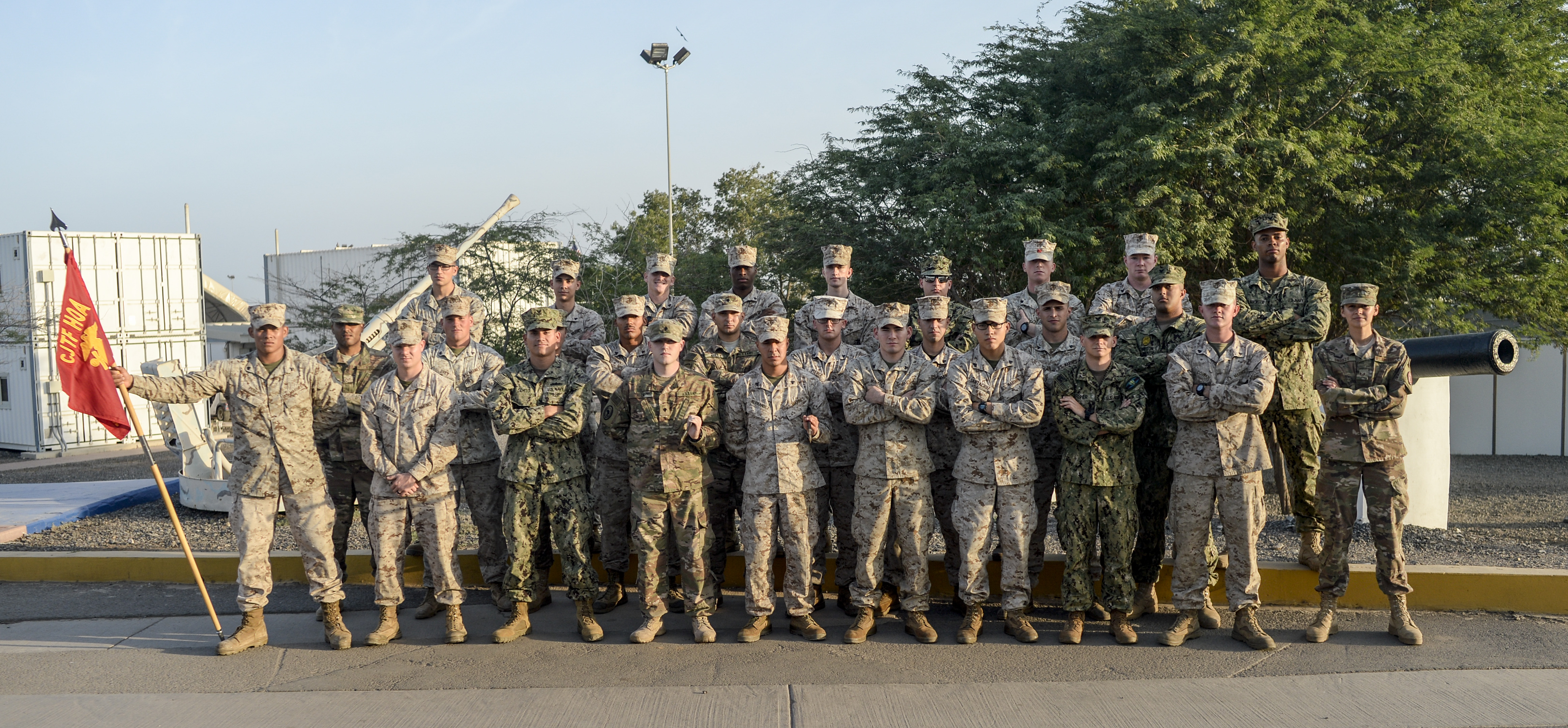 U.S. Marines, Sailors, Soldiers and Airmen pose for a class photo during the Joint Corporals Course at Camp Lemonnier, Djibouti, Jan. 20, 2017. The course, designed by the Marine Corps University, places significant emphasis on developing leadership to prepare junior enlisted service members for their transition from subordinates to small unit leaders.   (U.S. Air National Guard photo by Staff Sgt. Christian Jadot)
