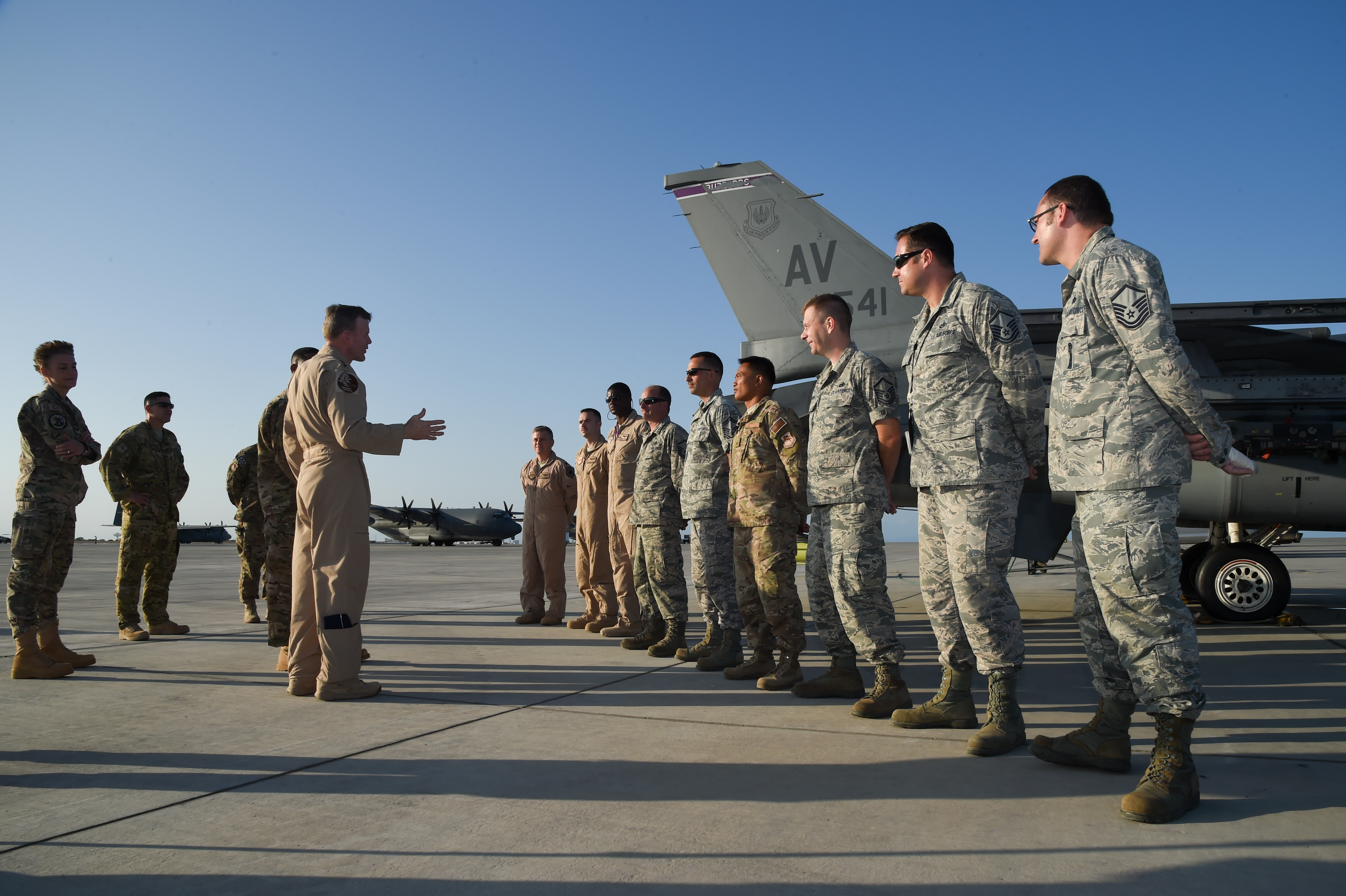 U.S. Air Force Gen. Tod Wolters, commander of U.S. Air Forces in Europe and Air Forces Africa, greets members of the 510th Expeditionary Fighter Squadron at Camp Lemonnier, Djibouti, Feb. 1, 2017. Wolters visited with U.S. Air Force members in Djibouti to gain insight into their integrated missions, and the multiple roles of Airmen in the joint environment. The members assembled nearby their assigned aircraft, an F-16 Fighting Falcon from Aviano Air Base, Italy.