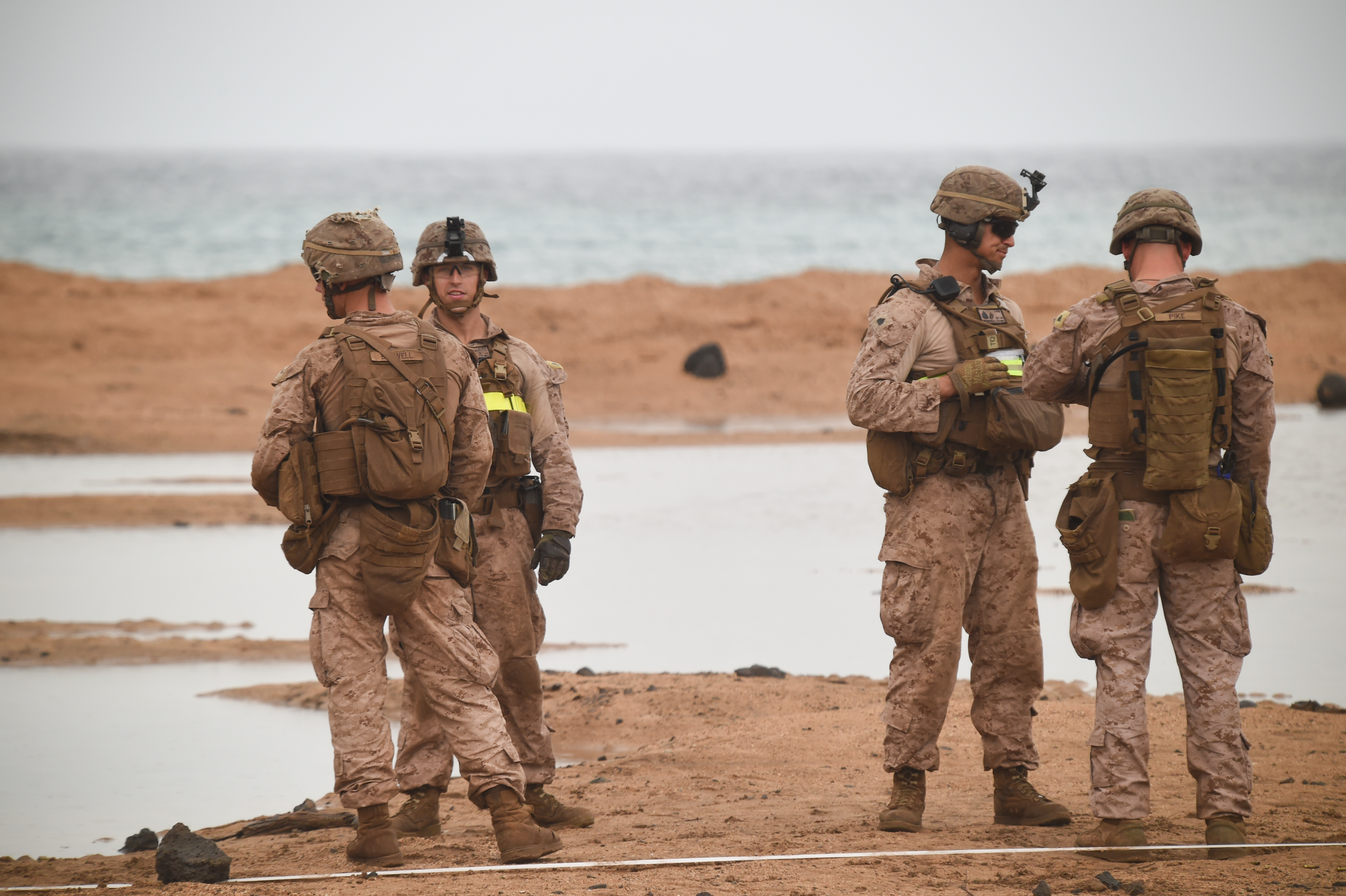 U.S. Marines with Alpha Company, 1st Battalion, 11th Marine Expeditionary Unit (MEU), stand at the edge of a range waiting for the next repetition of fire, Feb. 14, 2017, at Arta Beach in Djibouti. Marines worked on engaging a target while moving and under physical stress. A MEU is a forward-deployed, flexible sea-based Marine air-ground task force ready to respond to crisis and conduct limited contingency operations. (U.S. Air National Guard photo by Staff Sgt. Penny Snoozy)