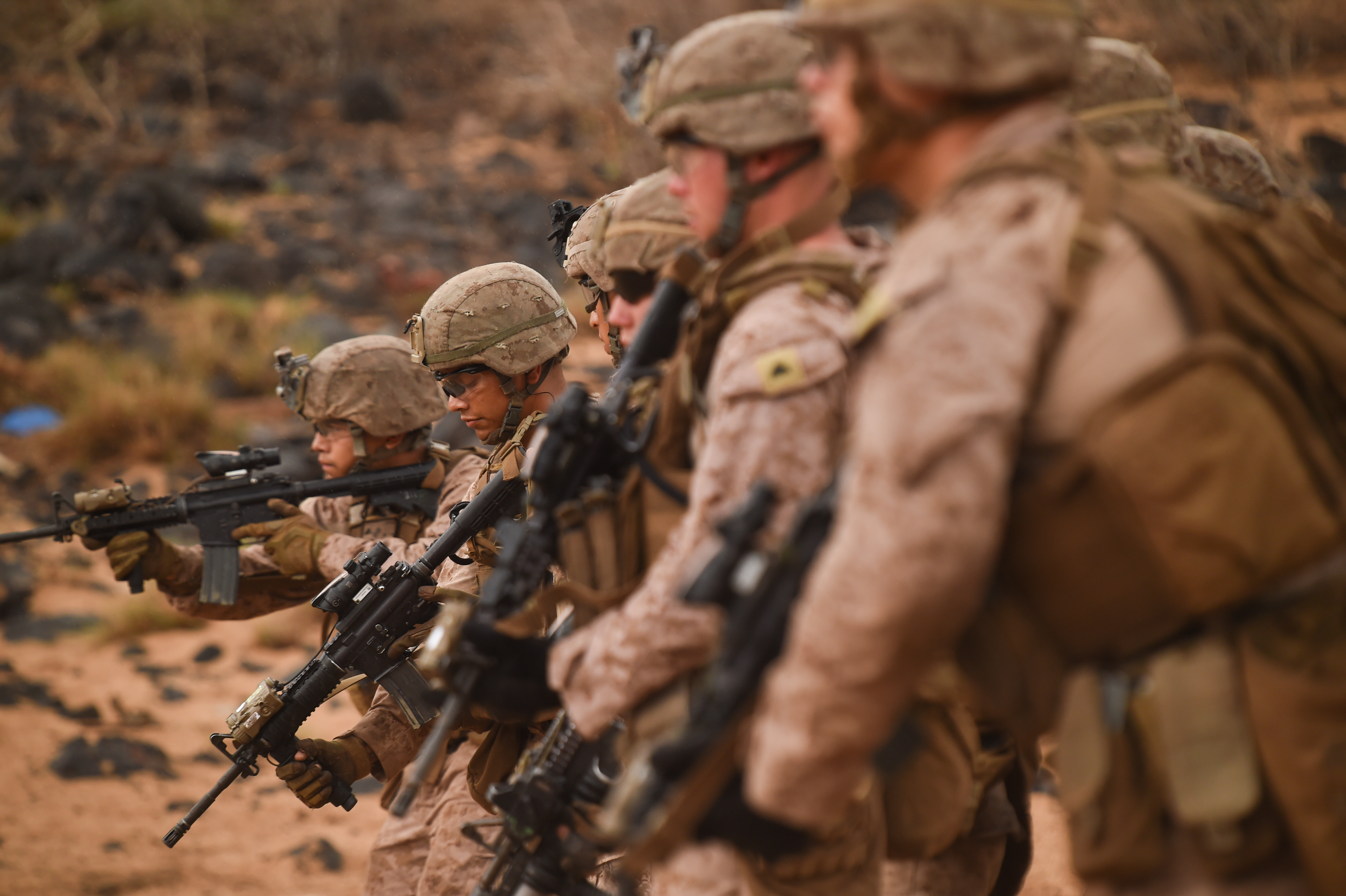 U.S. Marines with Alpha Company, 1st Battalion, 11th Marine Expeditionary Unit (MEU), prepare for the next repetition of fire during a Combat Marksmanship Program shoot, Feb. 14, 2017, at Arta Beach in Djibouti. Marines worked on engaging a target while moving and under physical stress. The time on the range allows the 11th MEU to maintain their respective skills and proficiencies. (U.S. Air National Guard photo by Staff Sgt. Penny Snoozy)