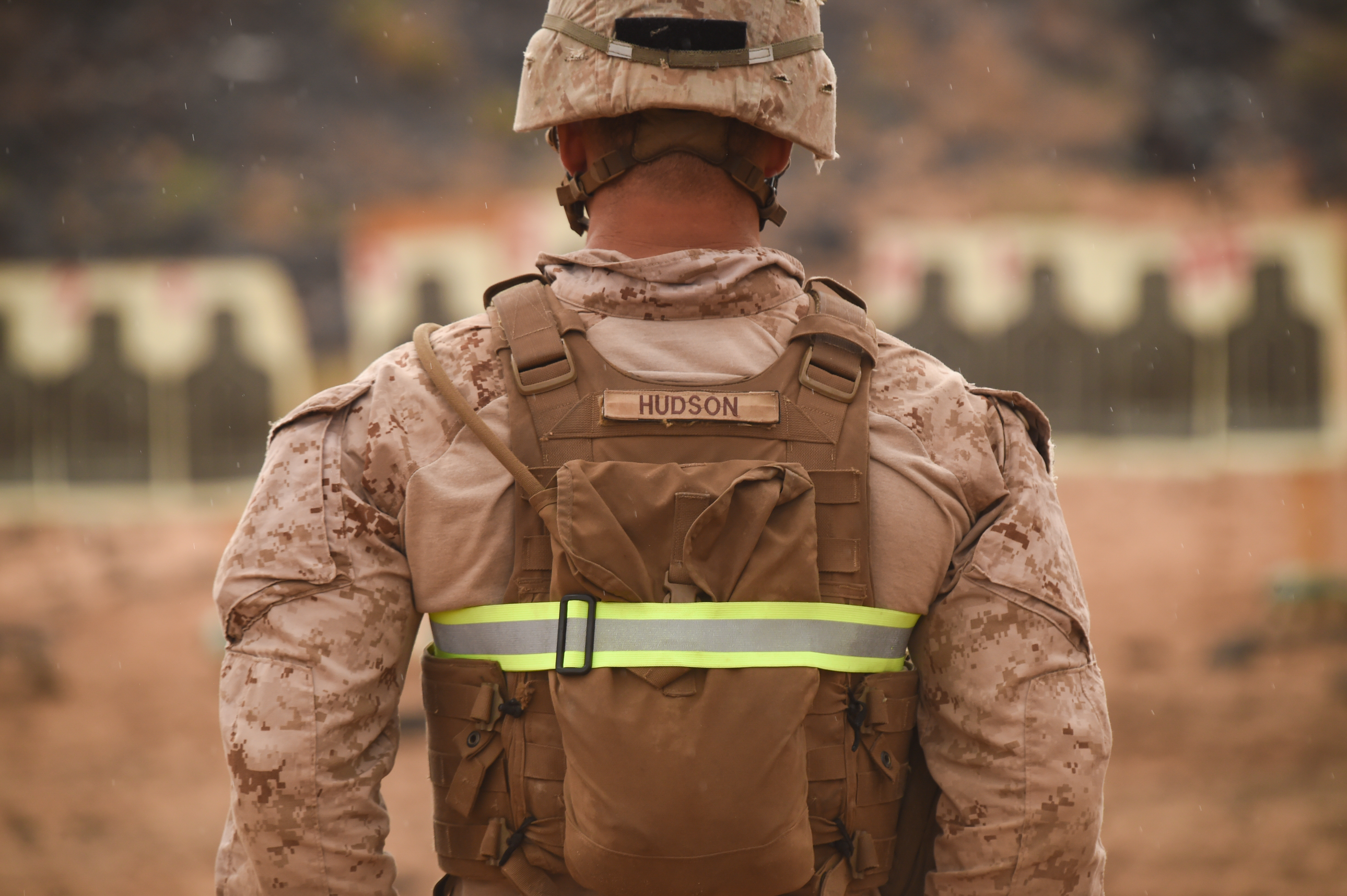 U.S. Marine Corps Sgt. Dylan Hudson, Alpha Company, 1st Battalion, 11th Marine Expeditionary Unit (MEU), stands at the edge of a range waiting for the next repetition of fire, Feb. 14, 2017, at Arta Beach in Djibouti. Marines worked on engaging a target while moving and under physical stress. A MEU is a quick response force, which consists of Sailors and Marines on standby for immediate crisis response across the globe. (U.S. Air National Guard photo by Staff Sgt. Penny Snoozy)