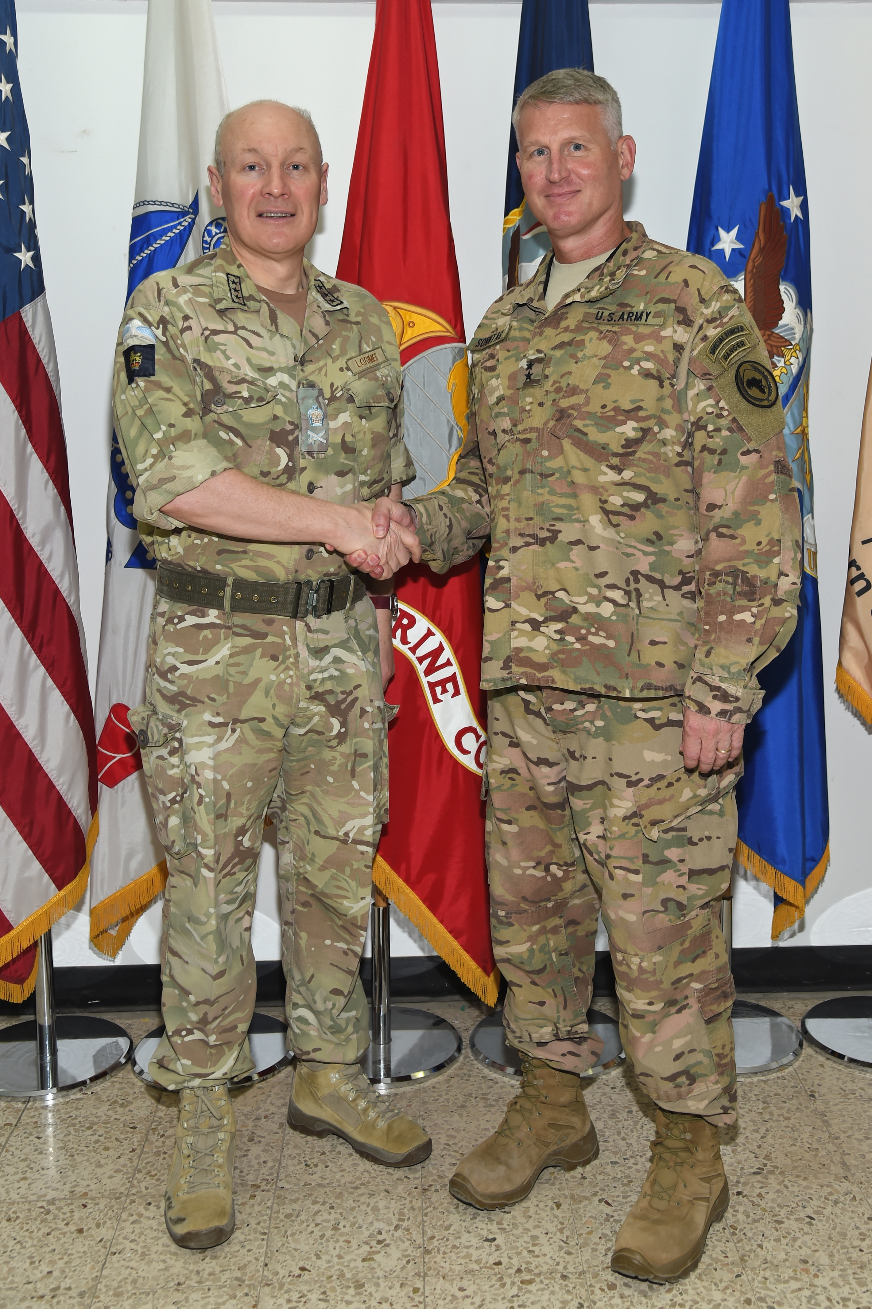 British Army Lt. Gen. Sir John Lorimer, chief of joint operations for Permanent Joint Headquarters in Great Britain meets with U.S. Army Maj. Gen. Kurt Sonntag, commanding general of the Combined Joint Task Force-Horn of Africa at Camp Lemonnier, Djibouti Feb. 21, 2017, while conducting a visit of U.K. military members serving in the Horn of Africa. The meeting allowed Lorimer to better understand U.S. plans for aiding with the stability and security of Somalia. (U.S. Air National Guard photo by Master Sgt. Paul Gorman)