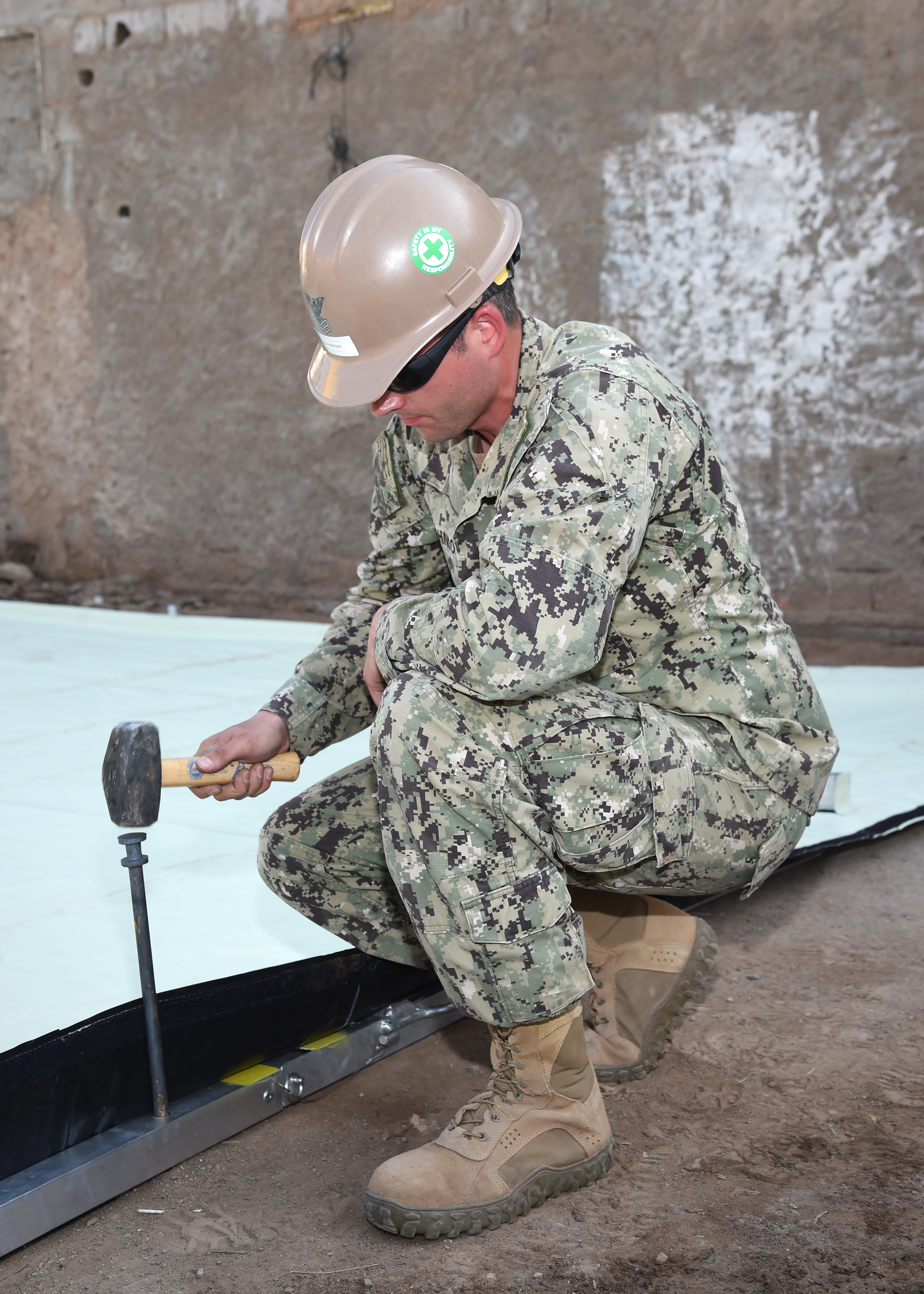 U.S. Navy Utilitiesman 1st Class Cole Johnson, a Seabee with Naval Mobile Construction Battalion 1, assists with the construction of a modular shelter system in Djibouti City, Feb. 27, 2017. Seabees assigned to Combined Joint Task Force-Horn of Africa helped Djiboutian soldiers construct the donated shelters for use as schools, clinics, and centers for cottage industry to promote the health, education and economic stability of the Djiboutian people. (U.S. Air National Guard photo by Master Sgt. Paul Gorman)