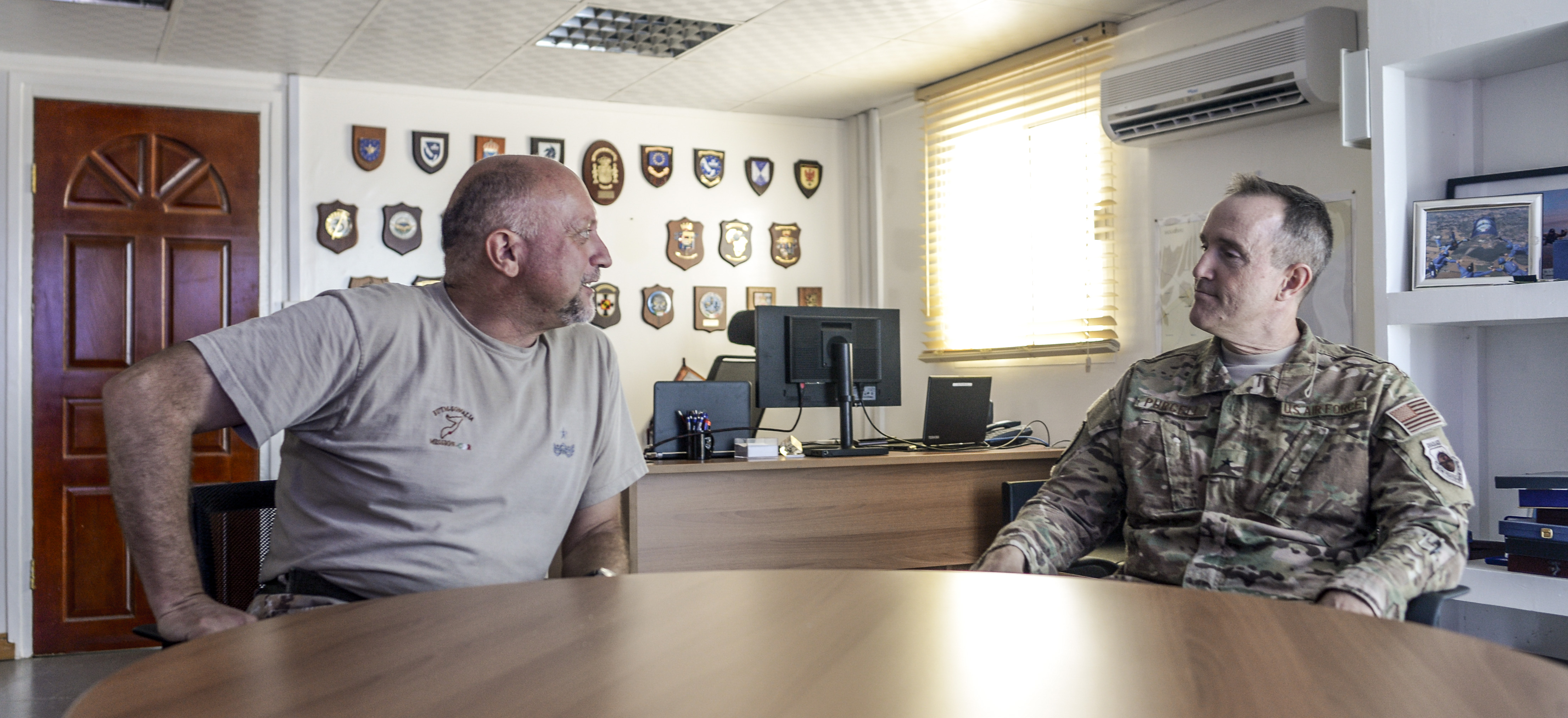 Italian army Brig. Gen. Maurizio Morena, European Union Training Mission in Somalia commander, discusses the current status of Mogadishu with U.S. Air Force Brig. Gen. Phil Purcell, Combined Joint Task Force-Horn of Africa deputy commander, in Mogadishu, Somalia March 15, 2017. Purcell travelled to Mogadishu to engage with various military leaders and foster relationships with key stakeholders in the region. (U.S. Air National Guard photo by Christian M. Jadot)