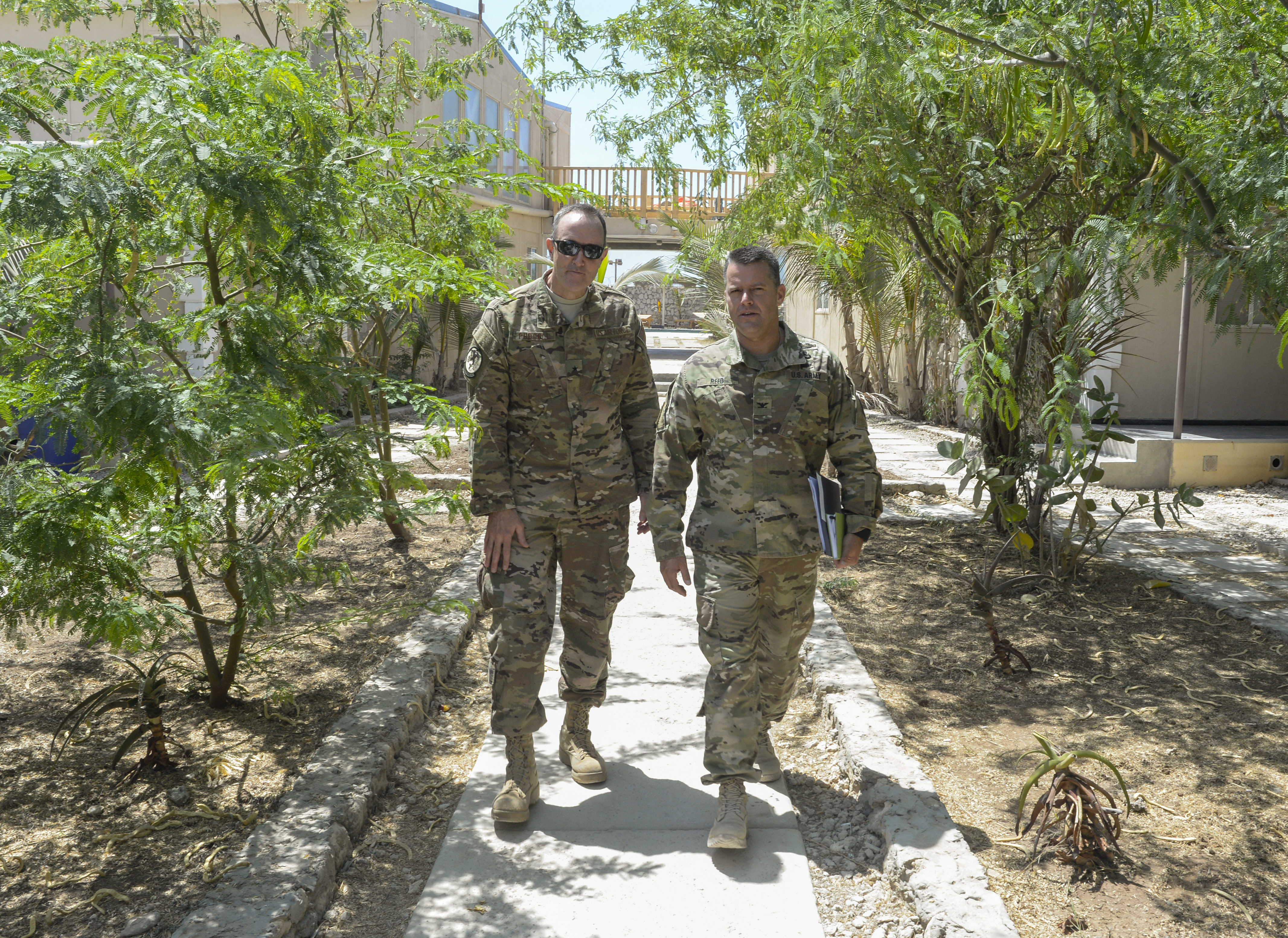 U.S. Air Force Brig. Gen. Phil Purcell, Combined Joint Task Force-Horn of Africa deputy commander, talks with U.S. Army Col. Kyle Reed, Military Coordination Cell Mogadishu director, in Mogadishu, Somalia, Mar. 15, 2017. Purcell travelled to Mogadishu to engage with various military leaders and foster relationships with key stakeholders in the region.(U.S. Air National Guard photo by Christian M. Jadot)