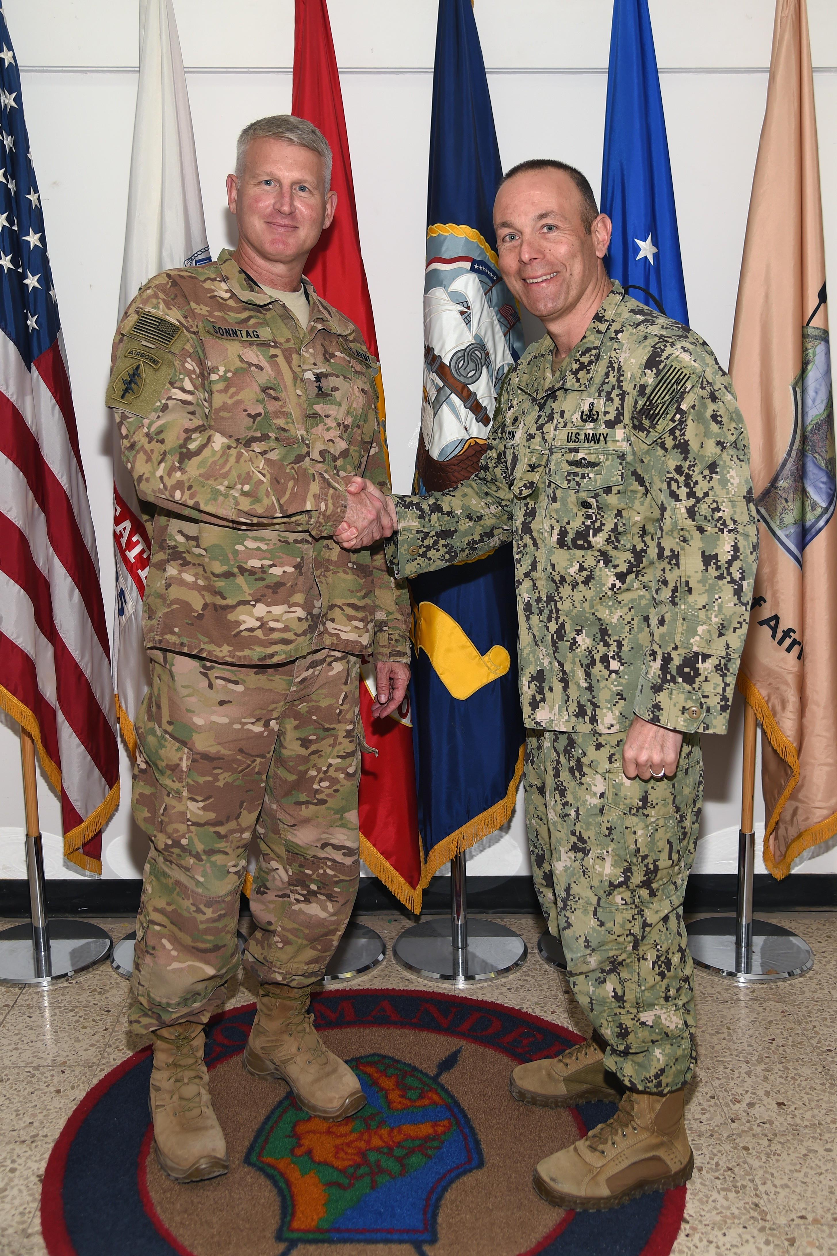 U.S. Navy Capt. Leonard Lyon, commander of Naval Expeditionary Task Force Europe and Africa (CTF 68) meets with U.S. Army Maj. Gen. Kurt Sonntag, commanding general of Combined Joint Task Force-Horn of Africa during a visit to Camp Lemonnier, Djibouti, March 15, 2017. CTF 68 conducts explosive ordnance disposal, naval construction, diving and salvage, hydrographic survey, expeditionary intelligence and theater security support in the U.S. 6th Fleet area of operations. (U.S. Air National Guard photo by Master Sgt. Paul Gorman)
