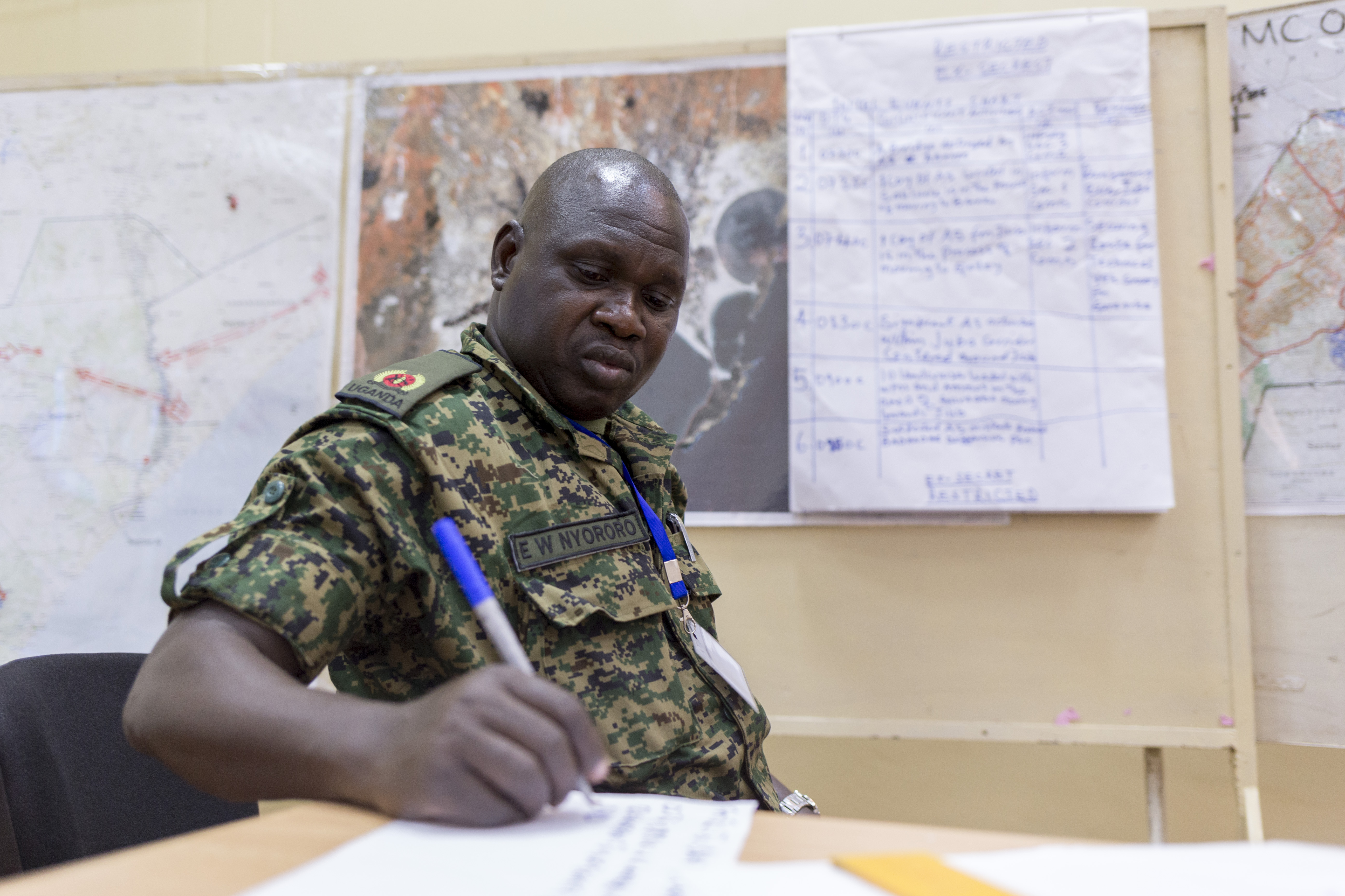 Uganda People's Defence Force Maj. E.W. Nyororo serves as a member of the logistics cell, preparing information to be presented in the daily commander update brief in response to simulated events during the command post exercise of the Africa Contingency Operations Training and Assistance force headquarters program held at the Humanitarian Peace Support School in Nairobi, Kenya, March 9, 2017. The five-week course was facilitated by the U.S. Department of State and is designed to improve Africa's military capabilities by providing selected training necessary for multinational peace support operations. (U.S. Army photo by Capt. Alán Ortiz)