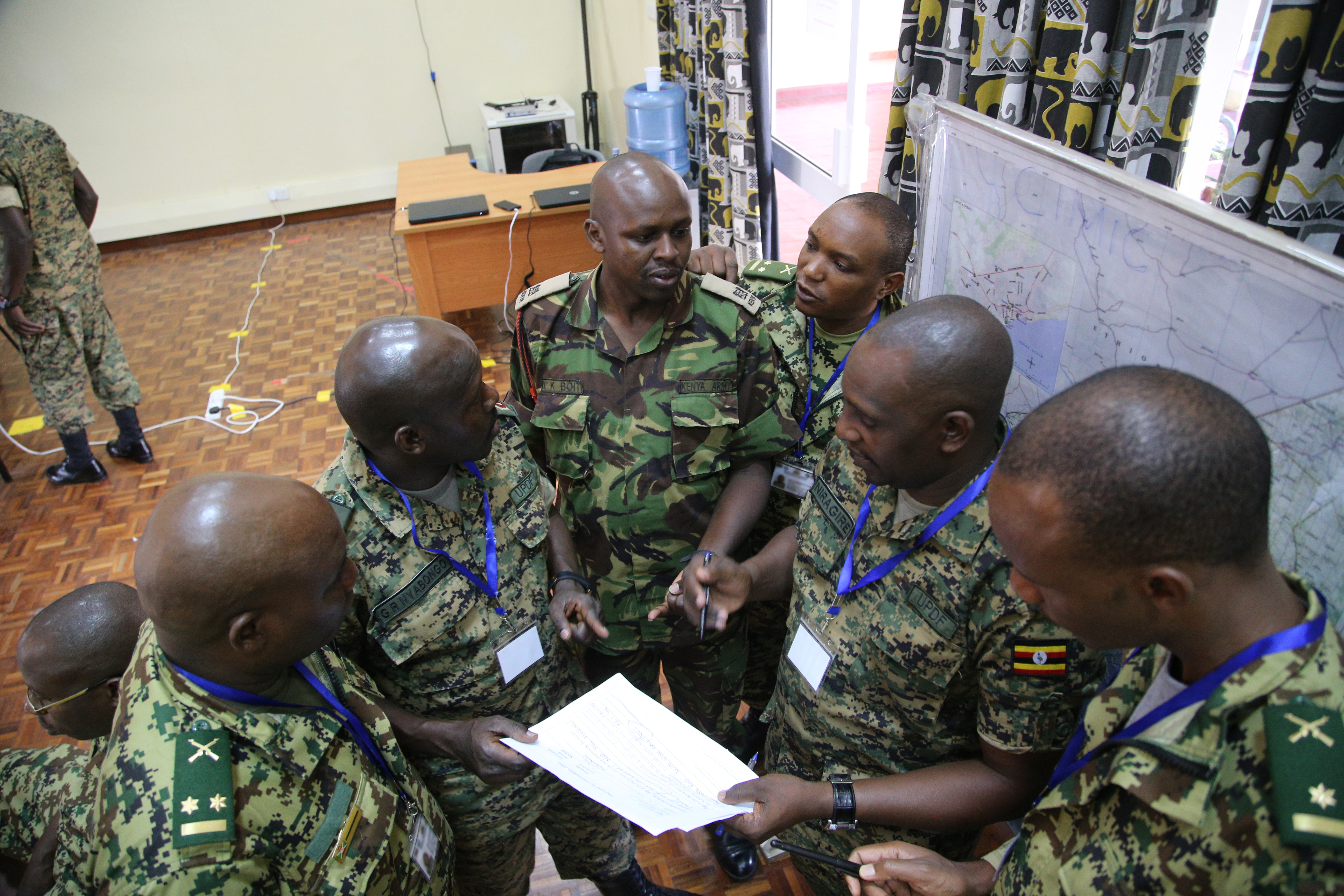 Officers from Uganda, Kenya and Burundi assigned to the Civil-Military Cooperation cell react to a simulated crisis, and prepare courses of action during the command post exercise of the Africa Contingency Operations Training and Assistance force headquarters training program held at the Humanitarian Peace Support School in Nairobi, Kenya, March 9, 2017. The five-week course was facilitated by the U.S. Department of State and is designed to improve Africa's military capabilities by providing selected training necessary for multinational peace support operations. (U.S. Army photo by Capt. Alán Ortiz)