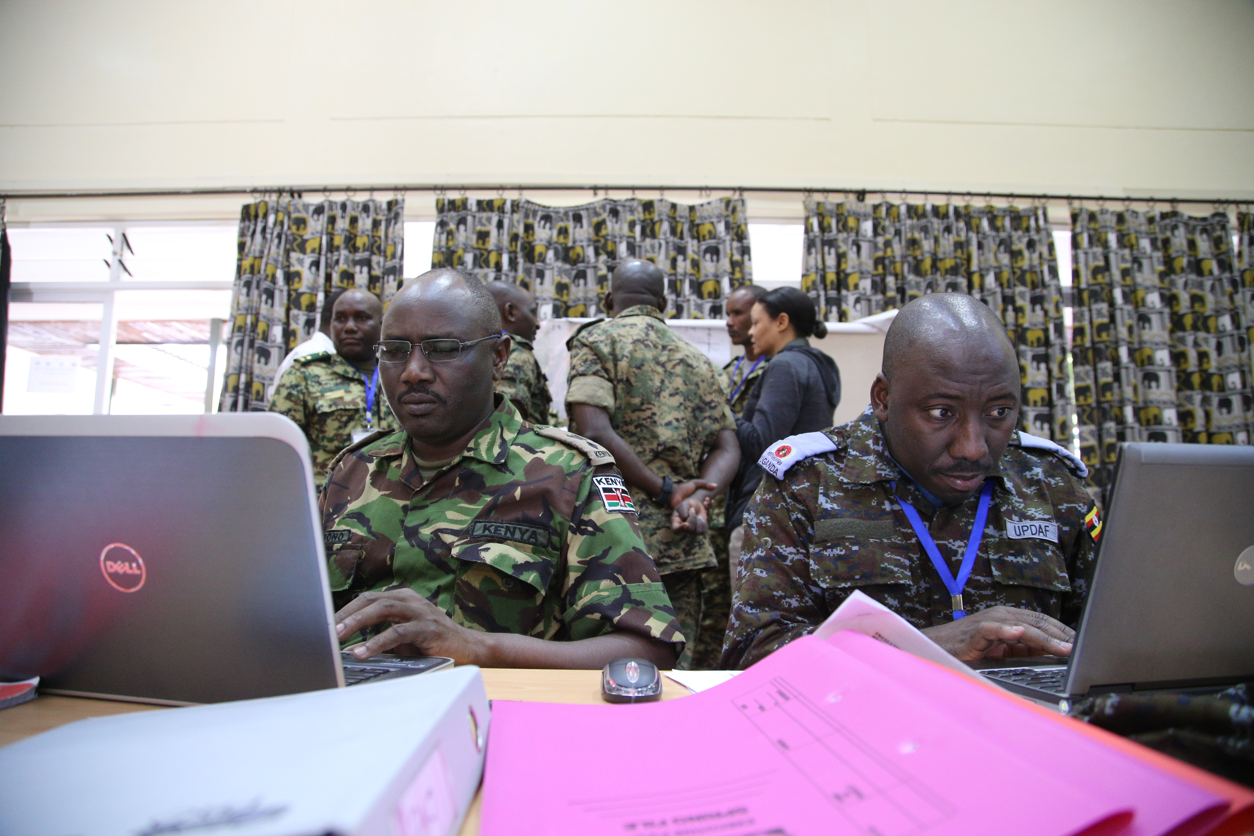 Kenya Defense Force Lt. Col. Wilson Ronoh and Uganda People's Defense Air Force Maj. Kiconco Anthony prepare themes and messages to counter simulated Al-Shabaab propaganda in the public affairs cell during the command post exercise of the Africa Contingency Operations Training and Assistance force headquarters training program held at the Humanitarian Peace Support School in Nairobi, Kenya, March 9, 2017. The five-week course was facilitated by the U.S. Department of State and is designed to improve Africa's military capabilities by providing selected training necessary for multinational peace support operations. (U.S. Army photo by Capt. Alán Ortiz)