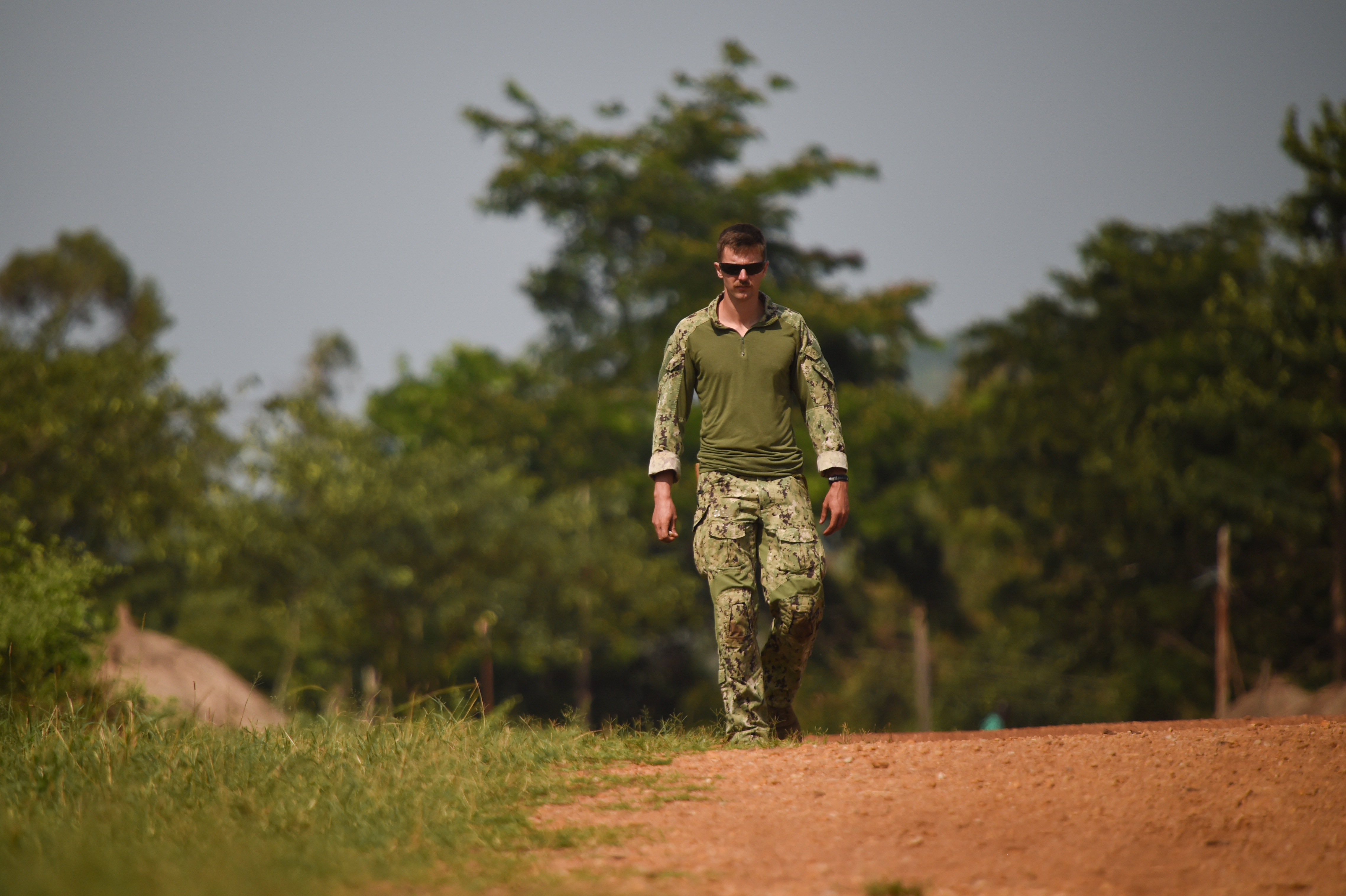 U.S. Navy Explosive Ordnance Disposal Technician 2nd Class Gary Lathrop, Combined Joint Task Force-Horn of Africa, Task Force Sparta, EOD Mobile Unit 8, walks along a road during counter improvised-explosive-device (IED) training at Camp Singo, Uganda, March 6, 2017.  The training gave UPDF members a chance to locate and clear IEDs in and around buildings and along the road. (U.S. Air National Guard photo by Staff Sgt. Penny Snoozy)