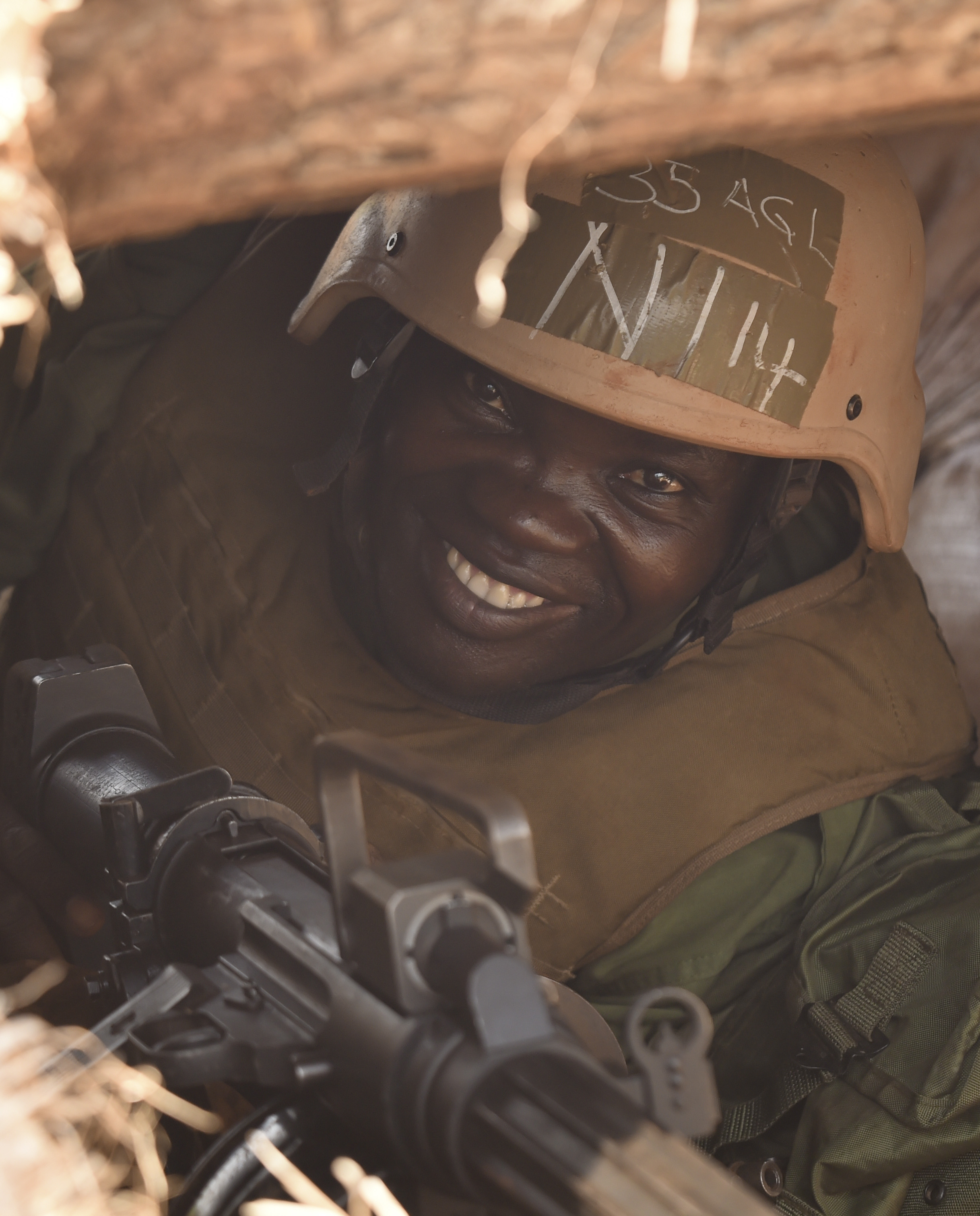 A Uganda People's Defense Force soldier, Ugandan Battle Group 22 (UGABAG 22), sits in a bunker before a live fire exercise at Camp Singo, Uganda, Feb. 27, 2017. UGABAG 22 will perform common task training, a combat lifesaver course, counter improvised-explosive-device training, and live fire training as a part of their pre-deployment preparation. (U.S. Air National Guard photo by Staff Sgt. Penny Snoozy)