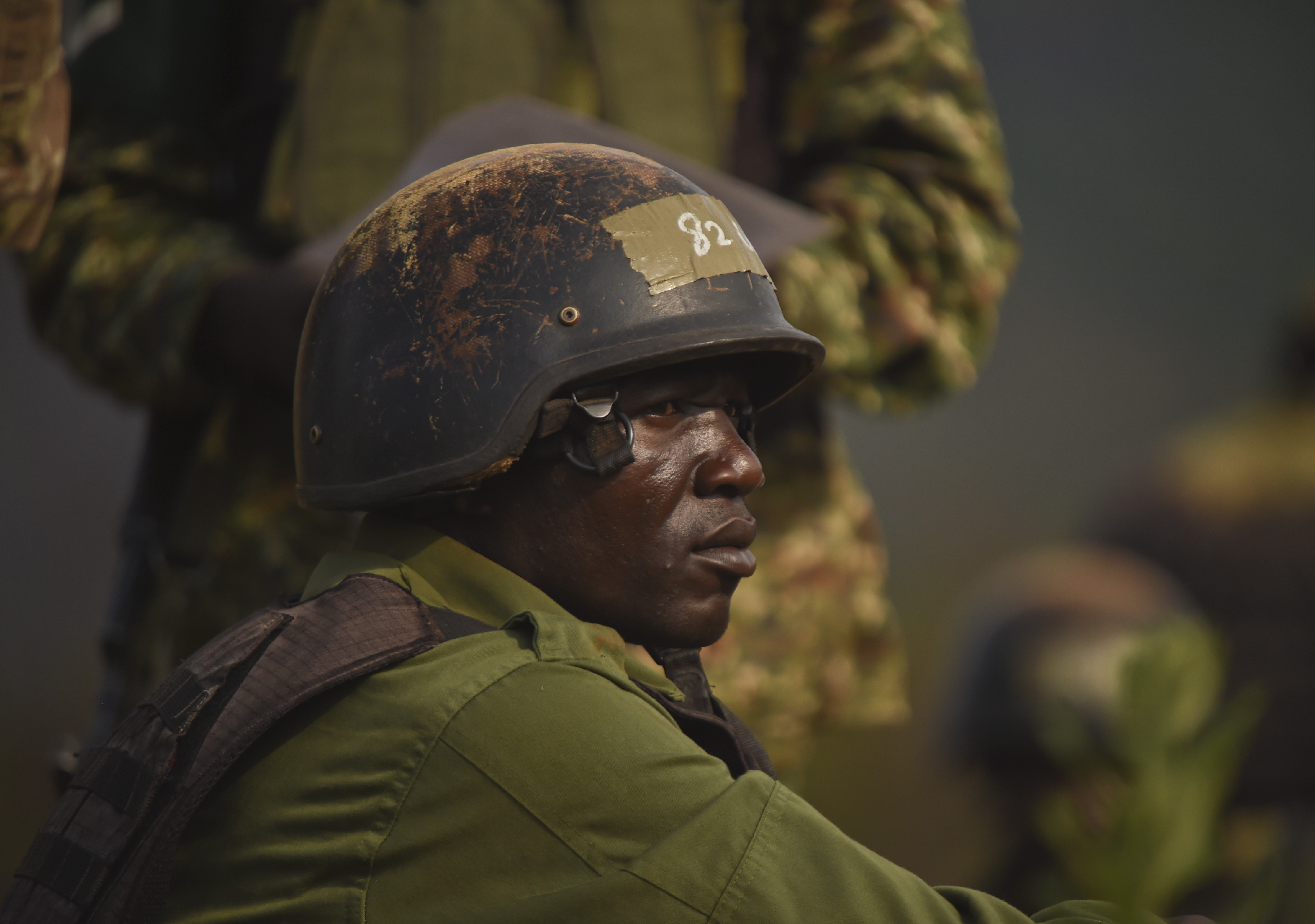 A Uganda People's Defense Force soldier, Ugandan Battle Group 22 (UGABAG 22), waits for the next round of mortar fire during a live fire exercise at Camp Singo, Uganda, Feb. 27, 2017. The training exercise is part of a 12-week pre-deployment training course for UGABAG 22. (U.S. Air National Guard photo by Staff Sgt. Penny Snoozy)