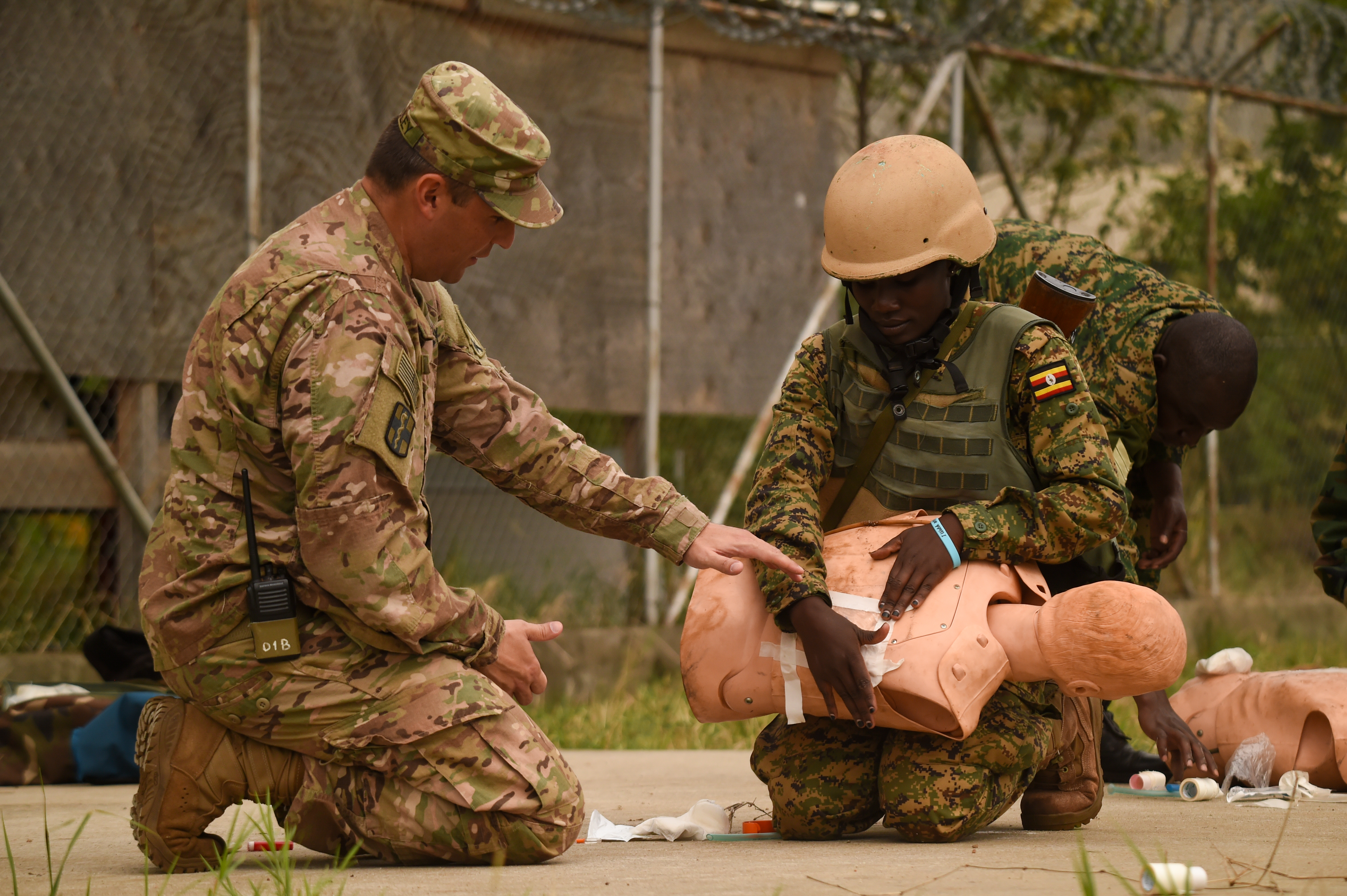 U.S. Army Lt. Col. Sean Dooley, functional specialty team officer in charge with Combined Joint Task Force-Horn of Africa's 418th Civil Affairs Battalion, helps a Uganda People's Defense Force (UPDF) soldier assigned to Ugandan Battle Group 22 (UGABAG 22), triage a chest wound during a medical exercise at Camp Singo, March 3, 2017. The UPDF's UGABAG 22 tested the skills they culminated earlier in their pre-deployment training such as nine-line medical evacuation, combat lifesaving techniques, and providing cover from an enemy during extractions. (U.S. Air National Guard photo by Staff Sgt. Penny Snoozy)