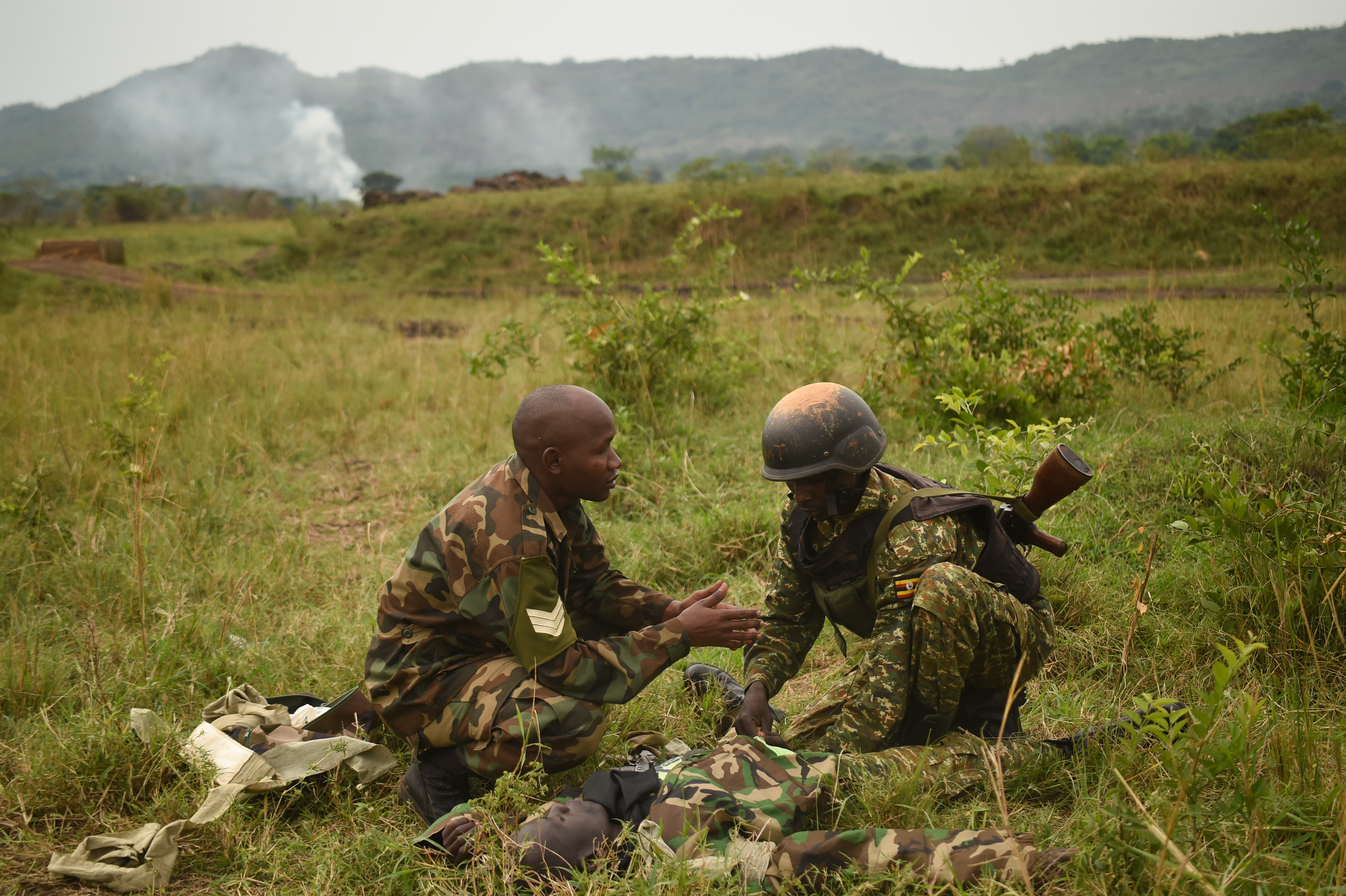 A Uganda People's Defense Force (UPDF) cadre member instructs a soldier during a medical exercise at Camp Singo, March 3, 2017. UPDF soldiers assigned to Ugandan Battle Group 22 employed skills acquired from their predeployment training such as nine-line medical evacuation, combat lifesaving techniques and casualty extraction. (U.S. Air National Guard photo by Staff Sgt. Penny Snoozy)