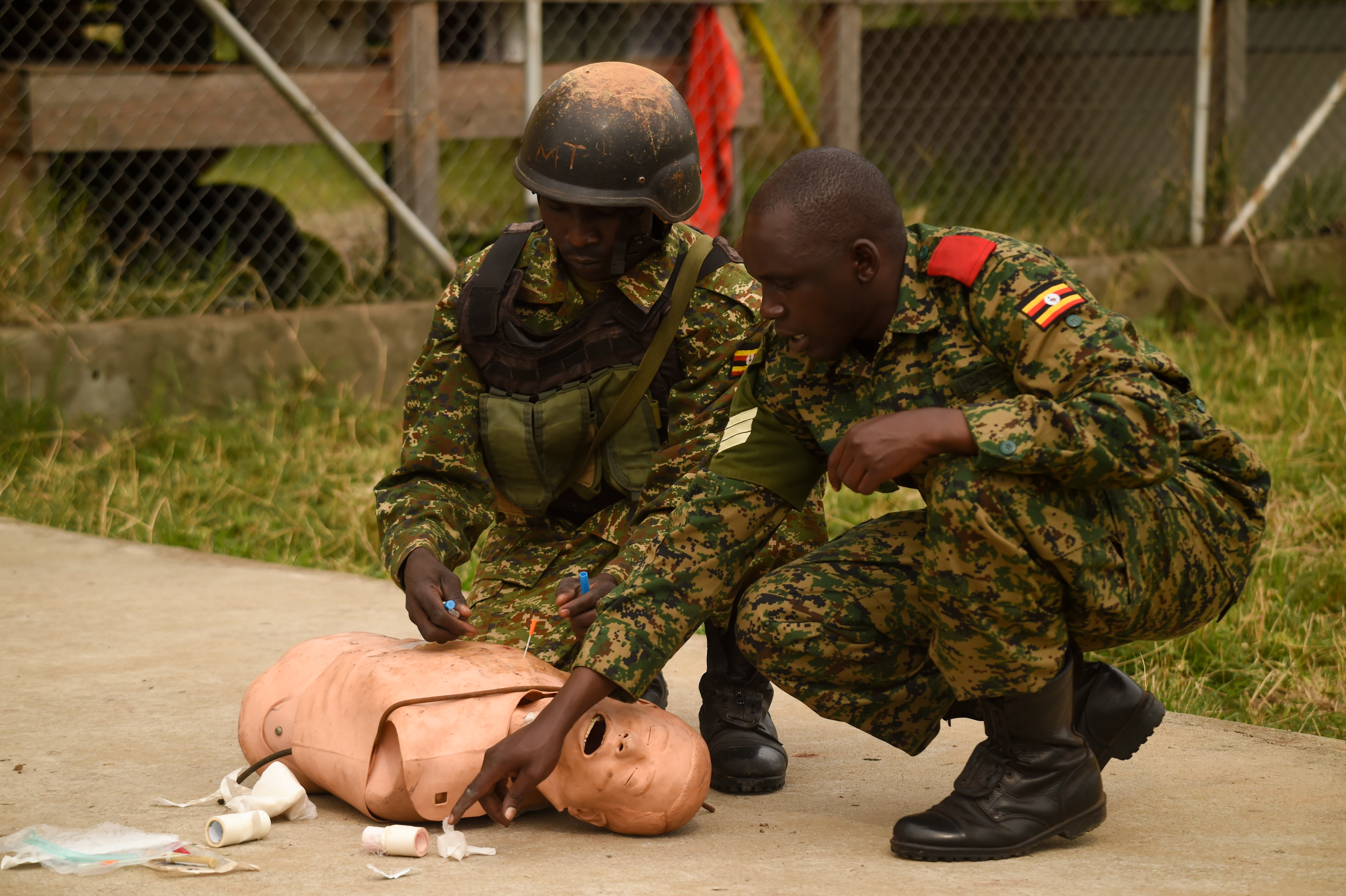 A Uganda People's Defense Force (UPDF) cadre member instructs a soldier on proper chest wound triage during a medical exercise at Camp Singo, March 3, 2017. UPDF soldiers assigned to Ugandan Battle Group 22 employed skills acquired from their predeployment training such as nine-line medical evacuation, combat lifesaving techniques and casualty extraction. (U.S. Air National Guard photo by Staff Sgt. Penny Snoozy)