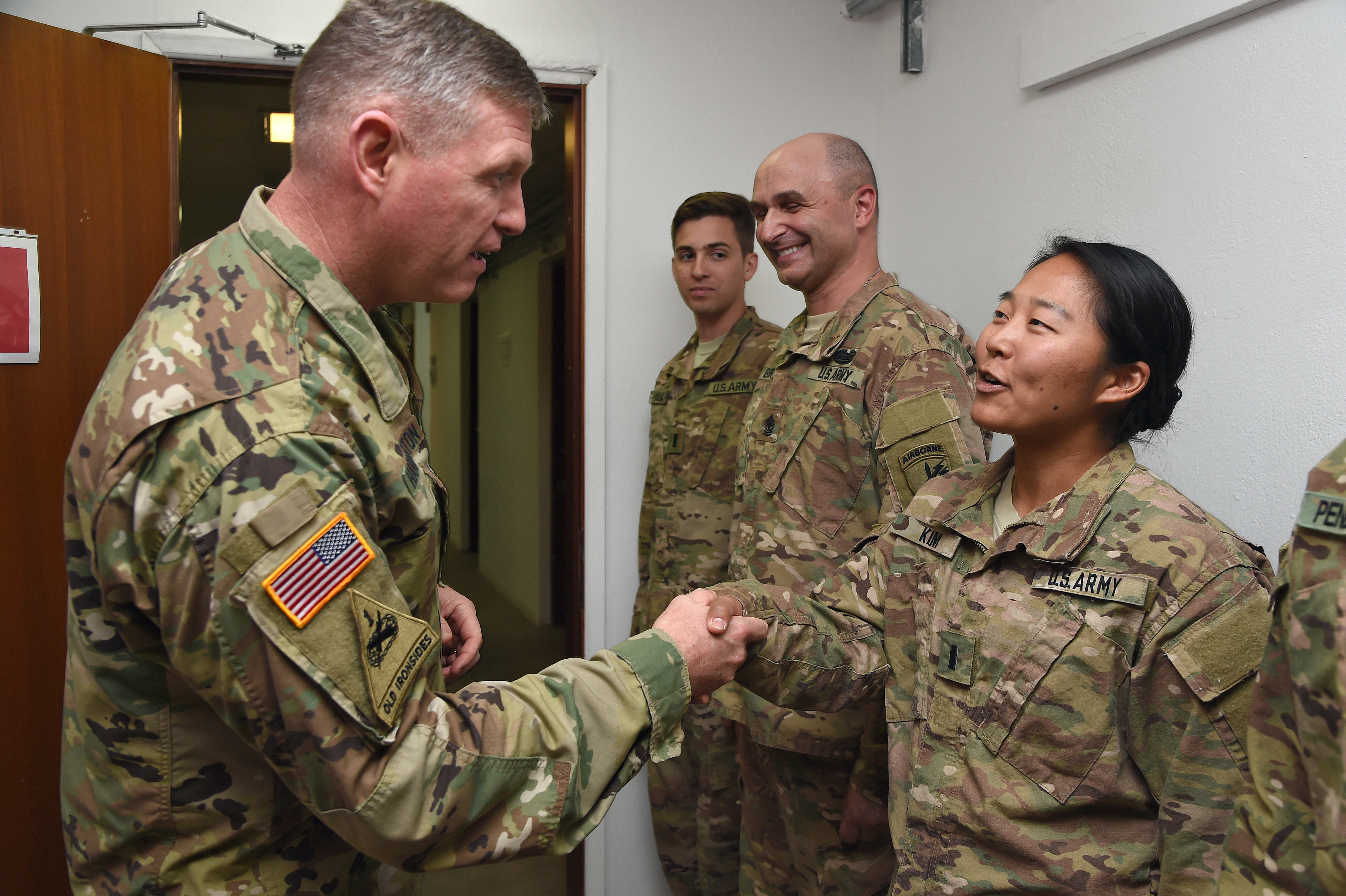 U.S. Army Maj. Gen. Joseph Harrington, commanding general of U.S. Army Africa recognizes 1st Lt. Elizabeth Kim for outstanding performance as officer in charge of environmental health at Camp Lemonnier, Djibouti, March 22, 2017. Harrington's visit included the opportunity to meet with Camp Lemonnier and Combined Joint Task Force-Horn of Africa leadership, as well as recognize numerous deployed Soldiers identified as superior performers while serving in the Horn of Africa. (U.S. Air National Guard photo by Master Sgt. Paul Gorman)