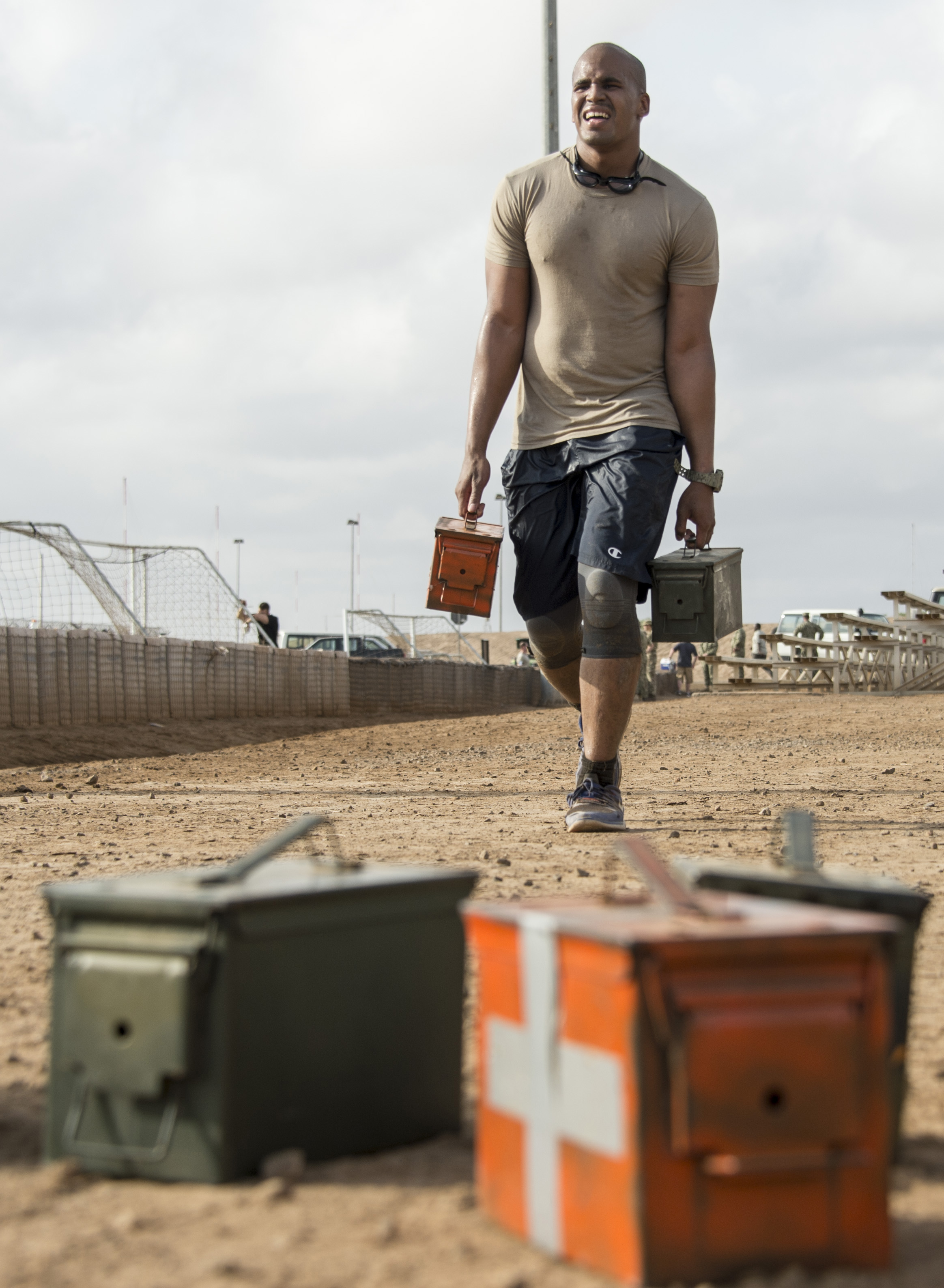 A U.S. service member participates in the ammunition can carry portion of the Joint Warrior Competition on Camp Lemonnier, Djibouti, March 25, 2017. Participants in the JWC test themselves physically in various events including a 100-yard ammunition can carry. (U.S. Air National Guard photo by Staff Sgt. Christian Jadot)