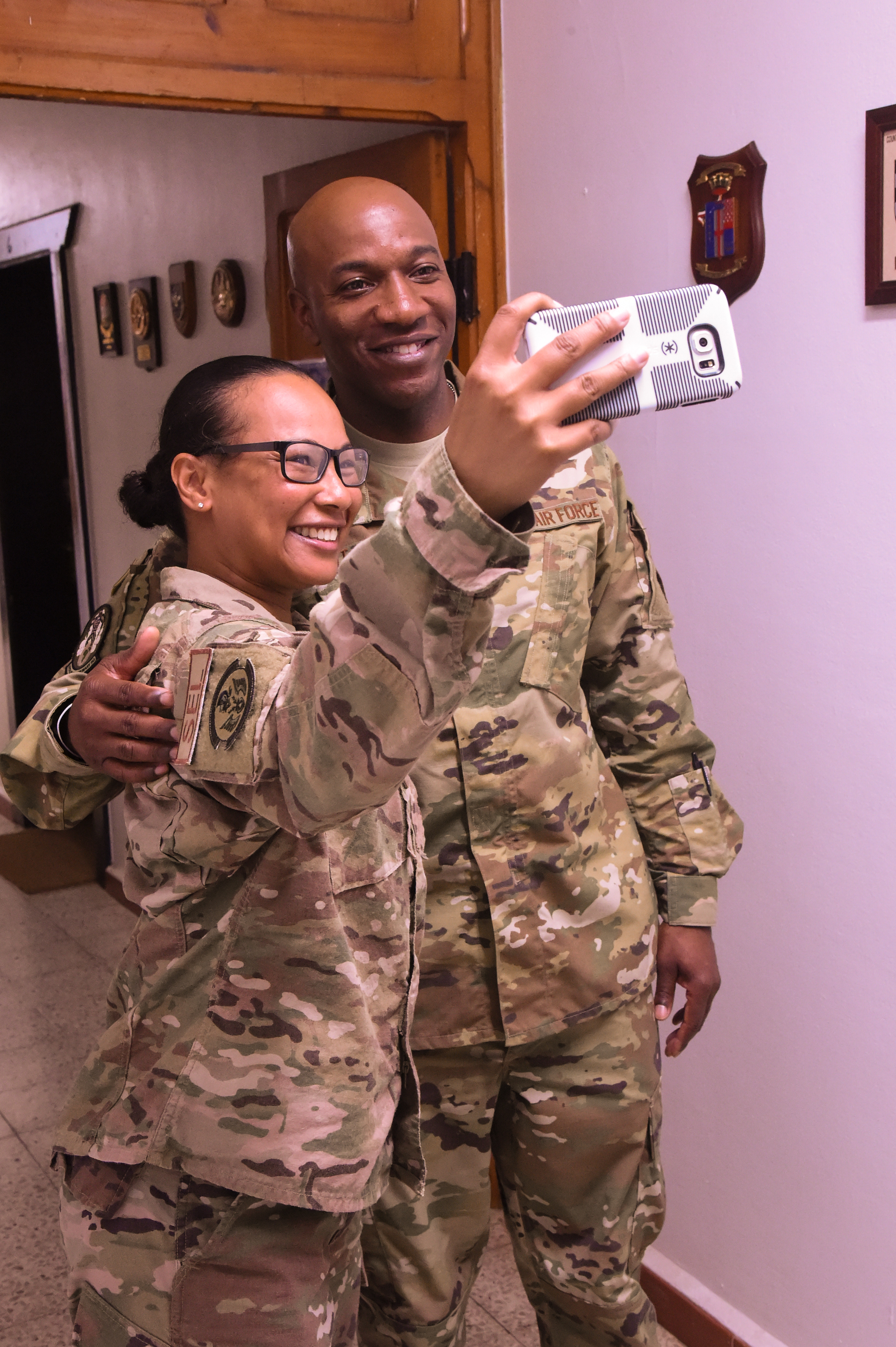 U.S. Air Force Chief Master Sgt. of the Air Force Kaleth Wright poses for a selfie photo with U.S. Air Force Master Sgt. Maricel Cofield, senior enlisted leader for the 726th Expeditionary Air Base Squadron, during his visit to Camp Lemonnier, Djibouti, April 11, 2017. The U.S. Air Force Vice Chief of Staff Gen. Stephen Wilson visited Combined Joint Task Force-Horn of Africa and tenant commands with Wright to gain a better understanding of Air Force integration and missions in the U.S. Africa Command area of responsibility. (U.S. Air National Guard photo by Staff Sgt. Penny Snoozy)