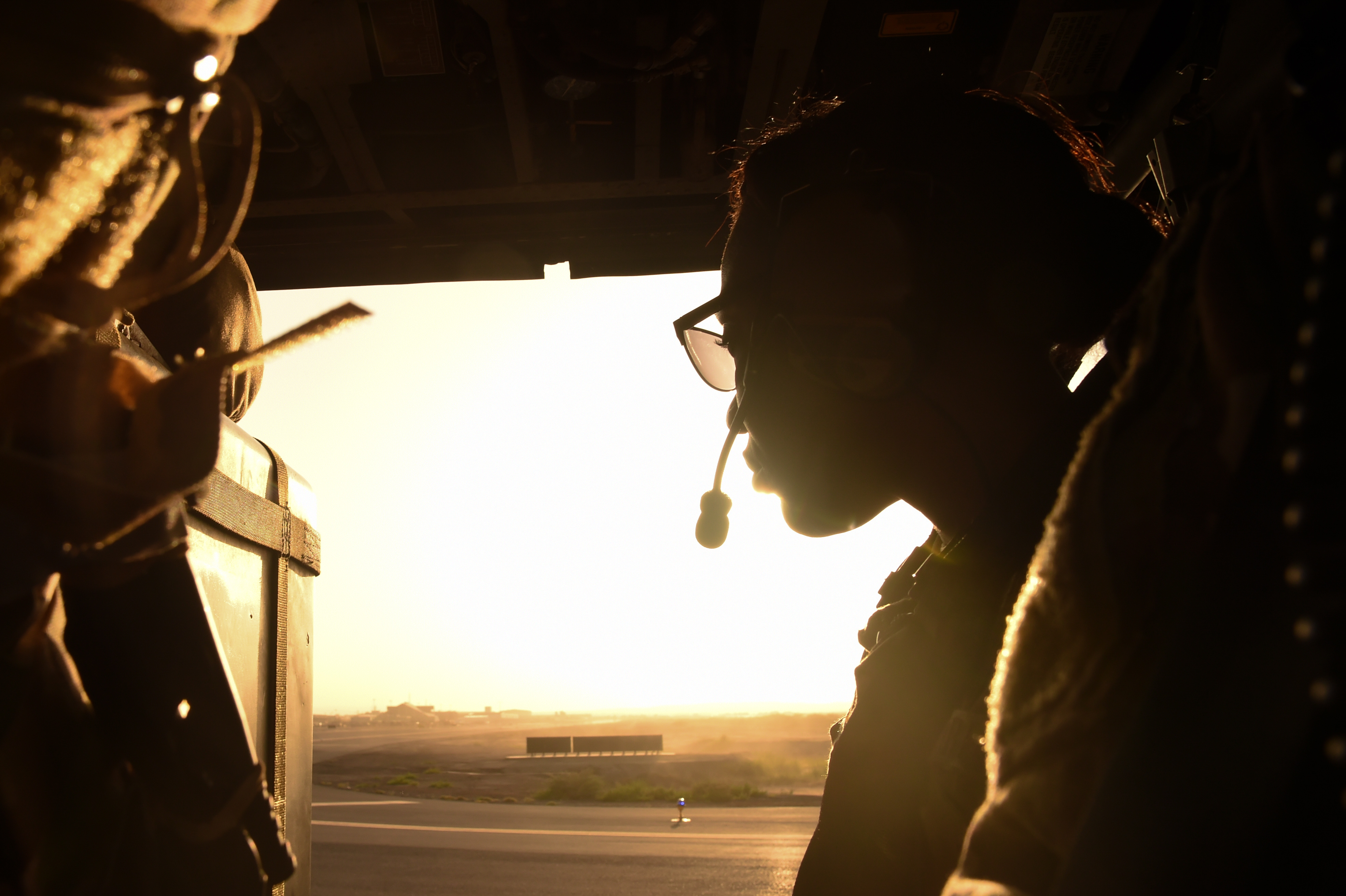 A U.S. Air Force member prepares for flight in an HH-60 during a visit to Camp Lemonnier, Djibouti, April 11, 2017. The General visited CJTF-HOA and its tenant commands with Chief Master Sgt. of the Air Force Kaleth Wright to gain a better understanding of Air Force integration and missions in the U.S. Africa Command area of responsibility. (U.S. Air National Guard photo by Staff Sgt. Penny Snoozy)