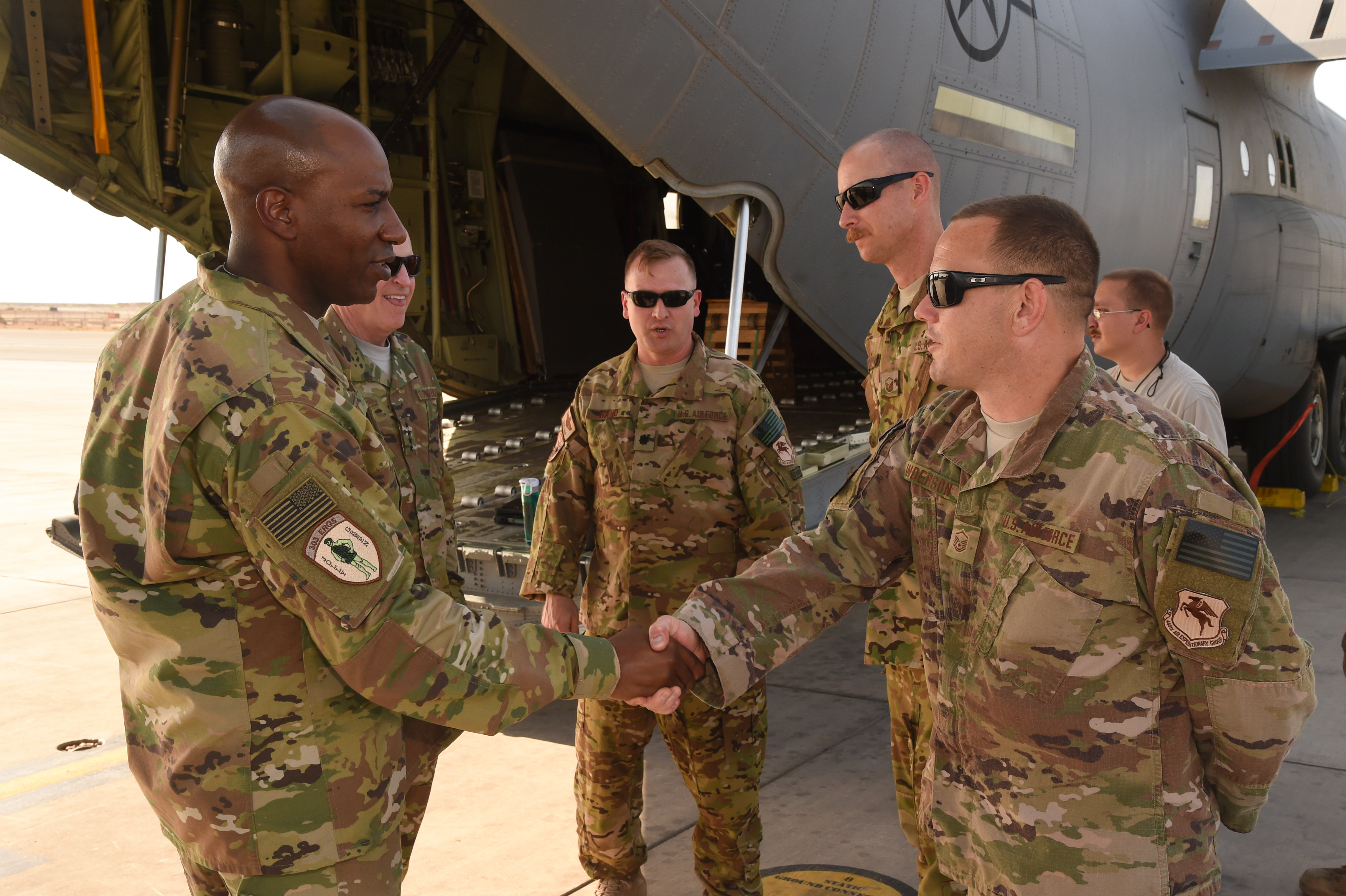 U.S. Air Force Chief Master Sgt. of the Air Force Kaleth Wright greets Master Sgt. Luke Anderson and other airmen from the 75th Expeditionary Airlift Squadron during a visit to Camp Lemonnier, Djibouti, April 11, 2017. Wilson and Wright visited CJTF-HOA and other tenant commands with Wright to gain a better understanding of Air Force integration and missions in the U.S. Africa Command area of responsibility. (U.S. Air National Guard photo by Staff Sgt. Penny Snoozy)