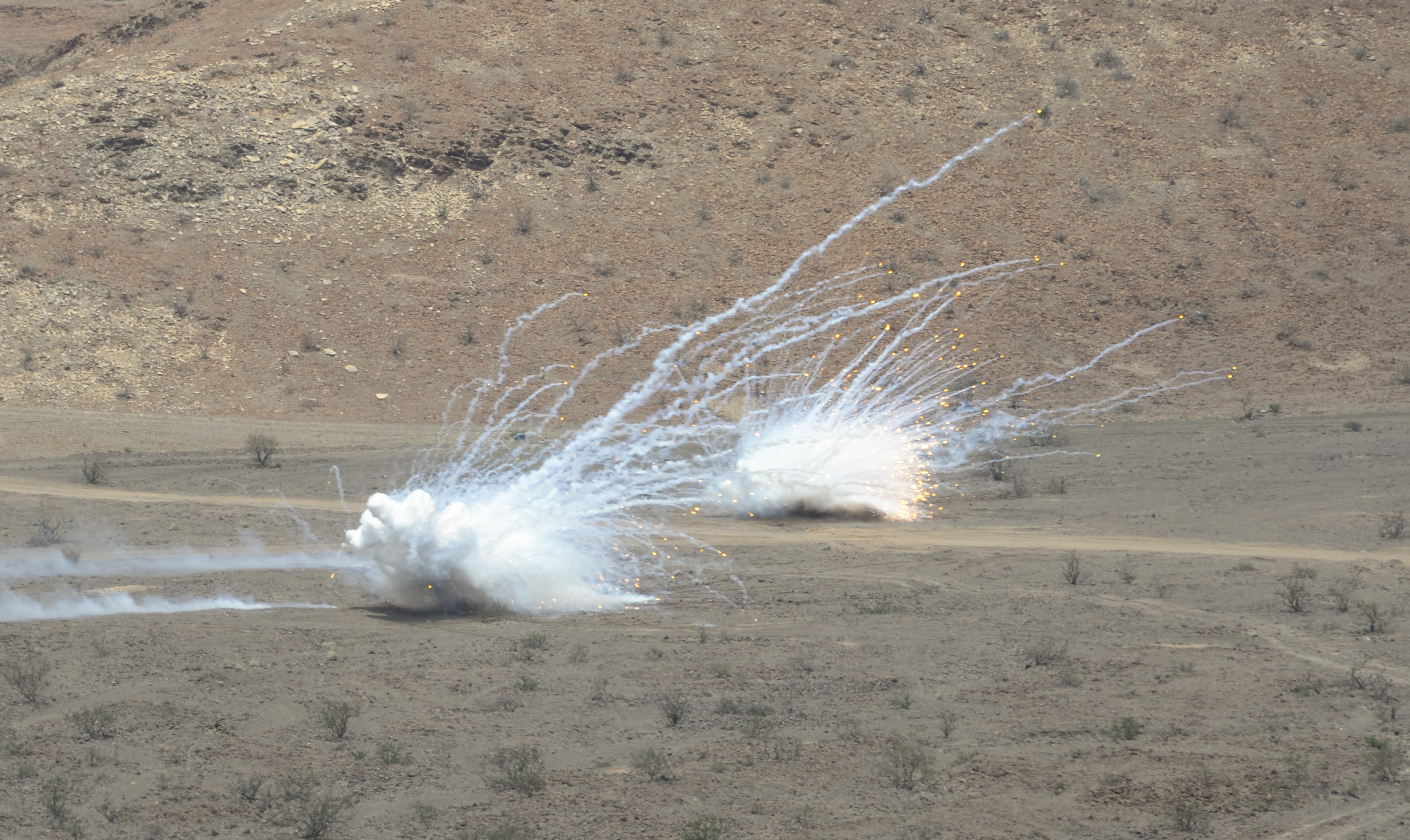 U.S. Marine artillery bombards a simulated target during Exercise Alligator Dagger at Arta Range, Djibouti, April 9, 2017. Exercise Alligator Dagger provides opportunities for the 24th Marine Expeditionary Unit to maintain their respective skills and proficiencies while intermittently participating in bilateral training with other services. Recurring training opportunities such as Alligator Dagger support the professional development of U.S. forces. (U.S. Air National Guard photo by Staff Sgt. Christian Jadot)