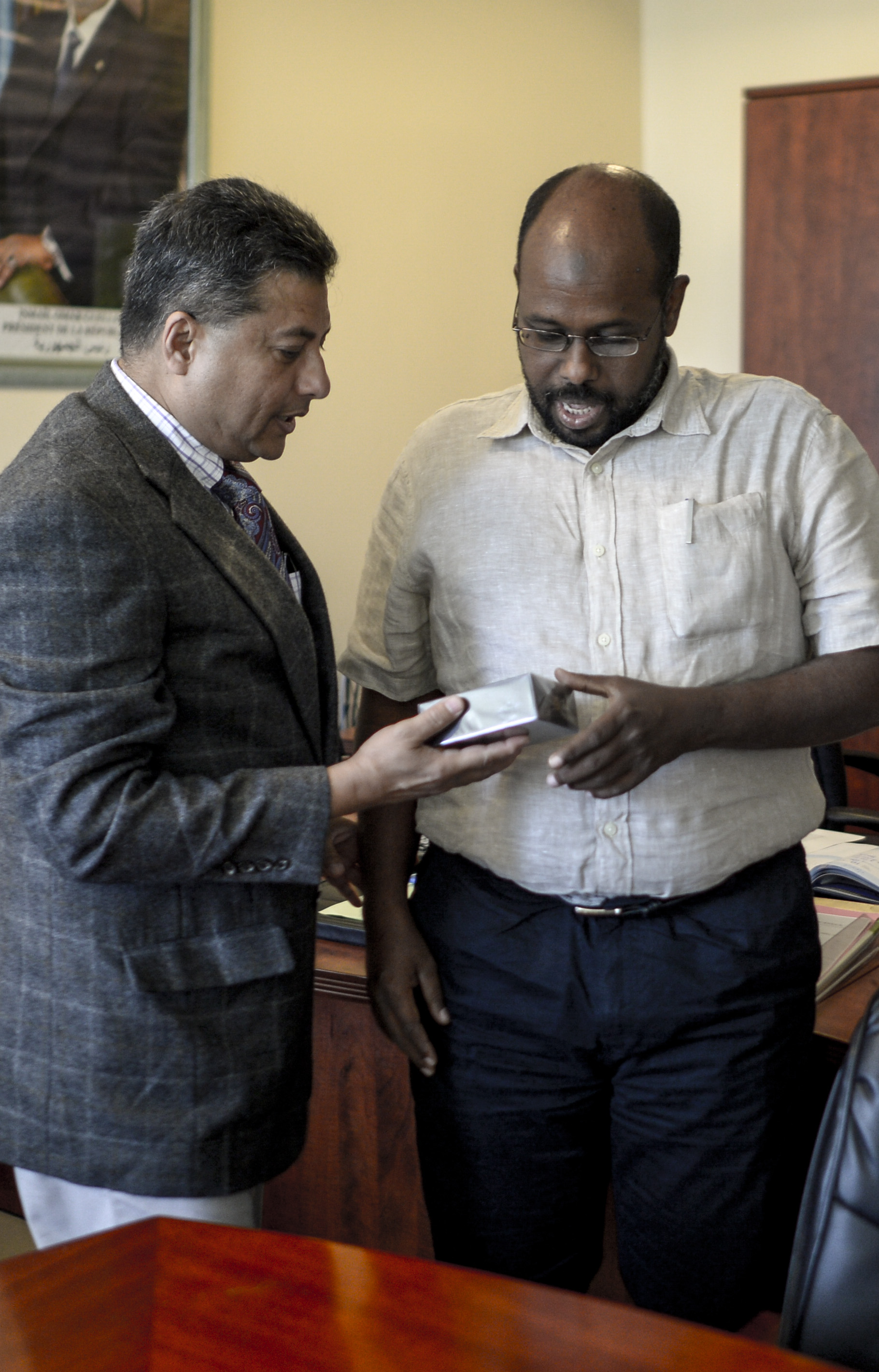 U.S. Navy Cmdr. Abuhena Saifulislam, deputy command chaplain for U.S. Africa Command, meets with Mohamed Houssein Doualeh, Djibouti's deputy minister of Muslim affairs & charitable assets in downtown Djibouti City, April 11, 2017. Regular engagements with Muslim leaders in Djibouti and neighboring countries helps to foster positive relationships between the U.S. and Islamic communities in east Africa. (U.S. Air National Guard photo by Staff Sgt. Christian Jadot)